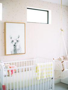 pink nursery with alpaca on the walll