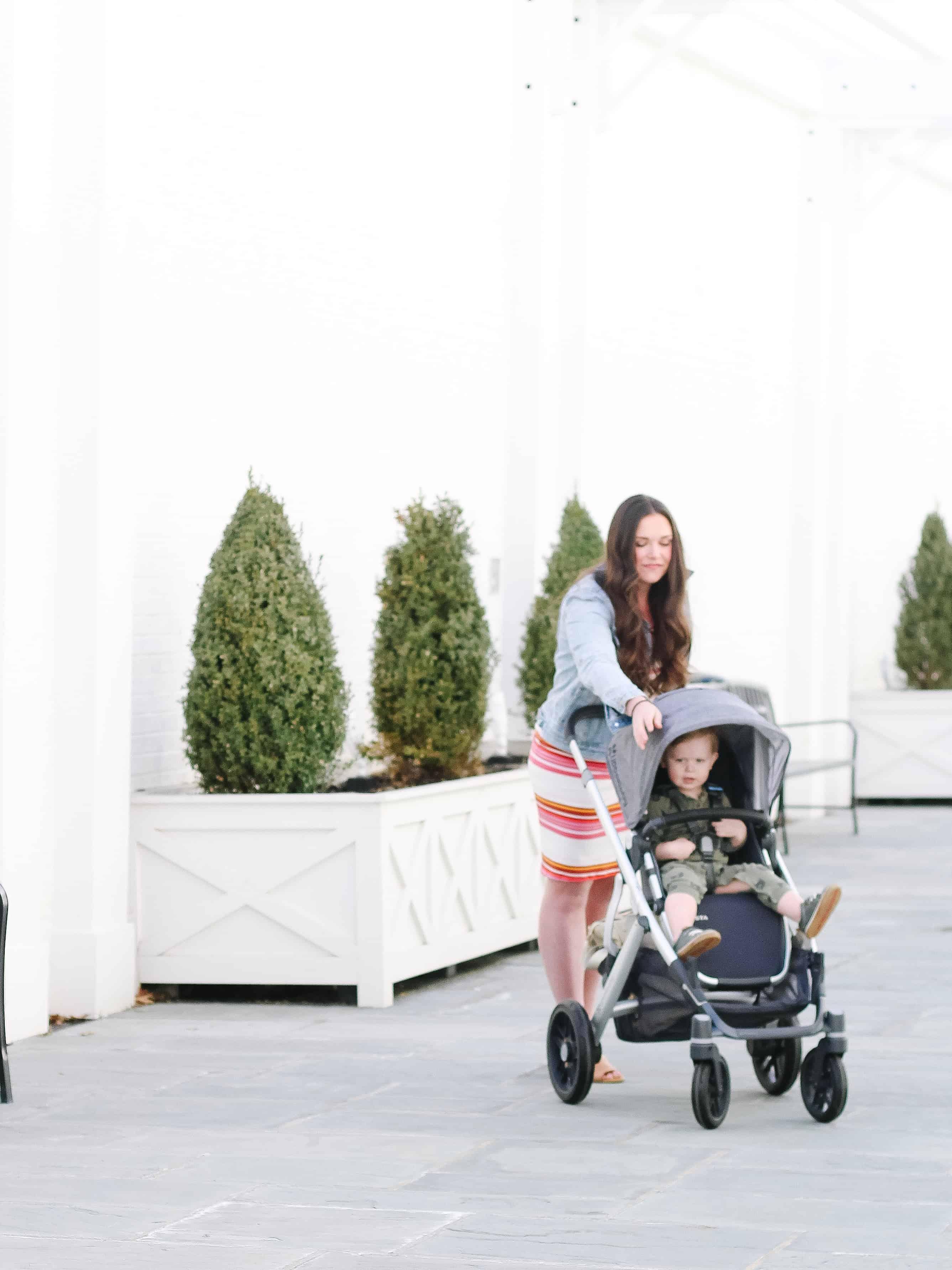 mom pushing uppa baby vista stroller with toddler