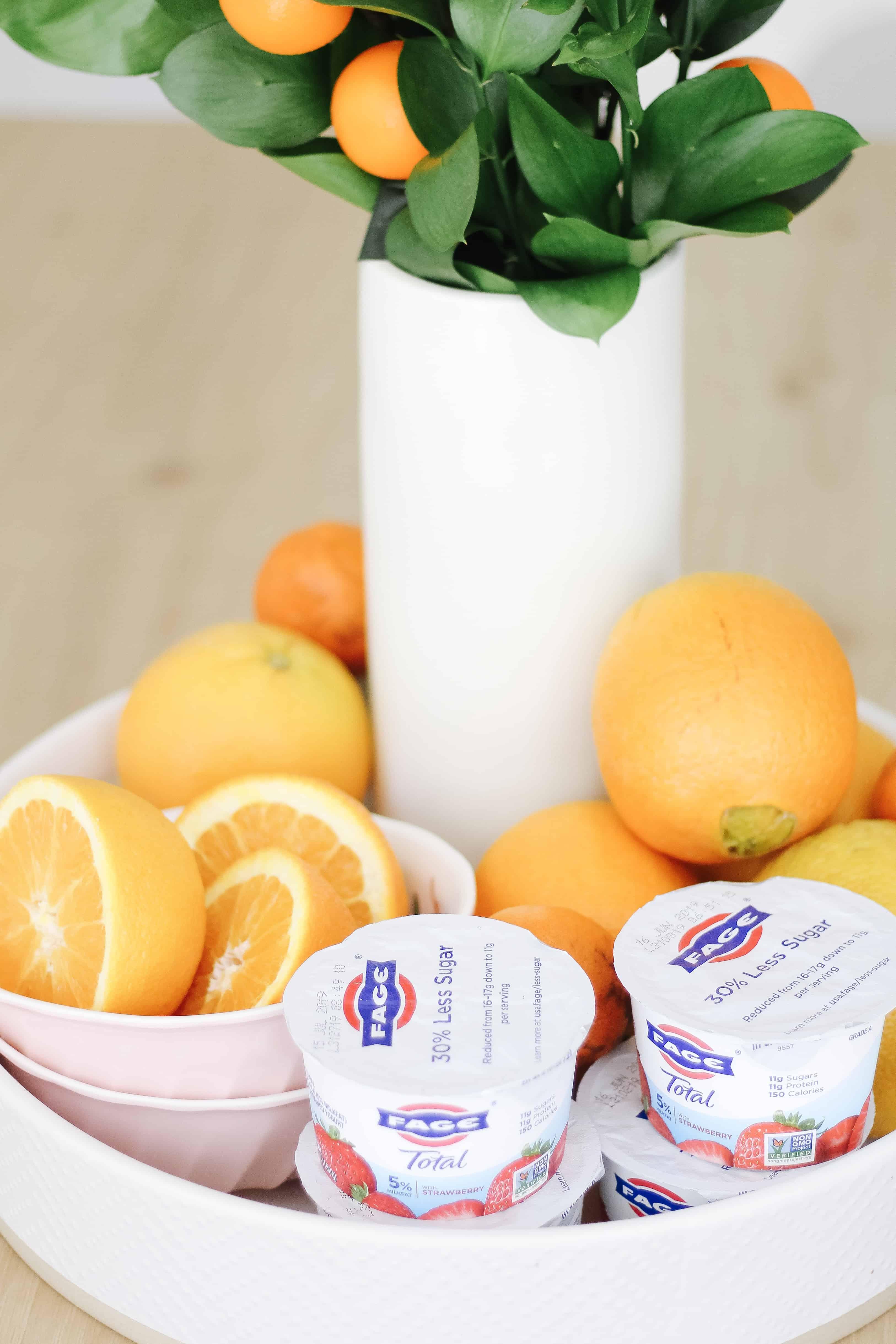 Fage yogurt on tray with oranges