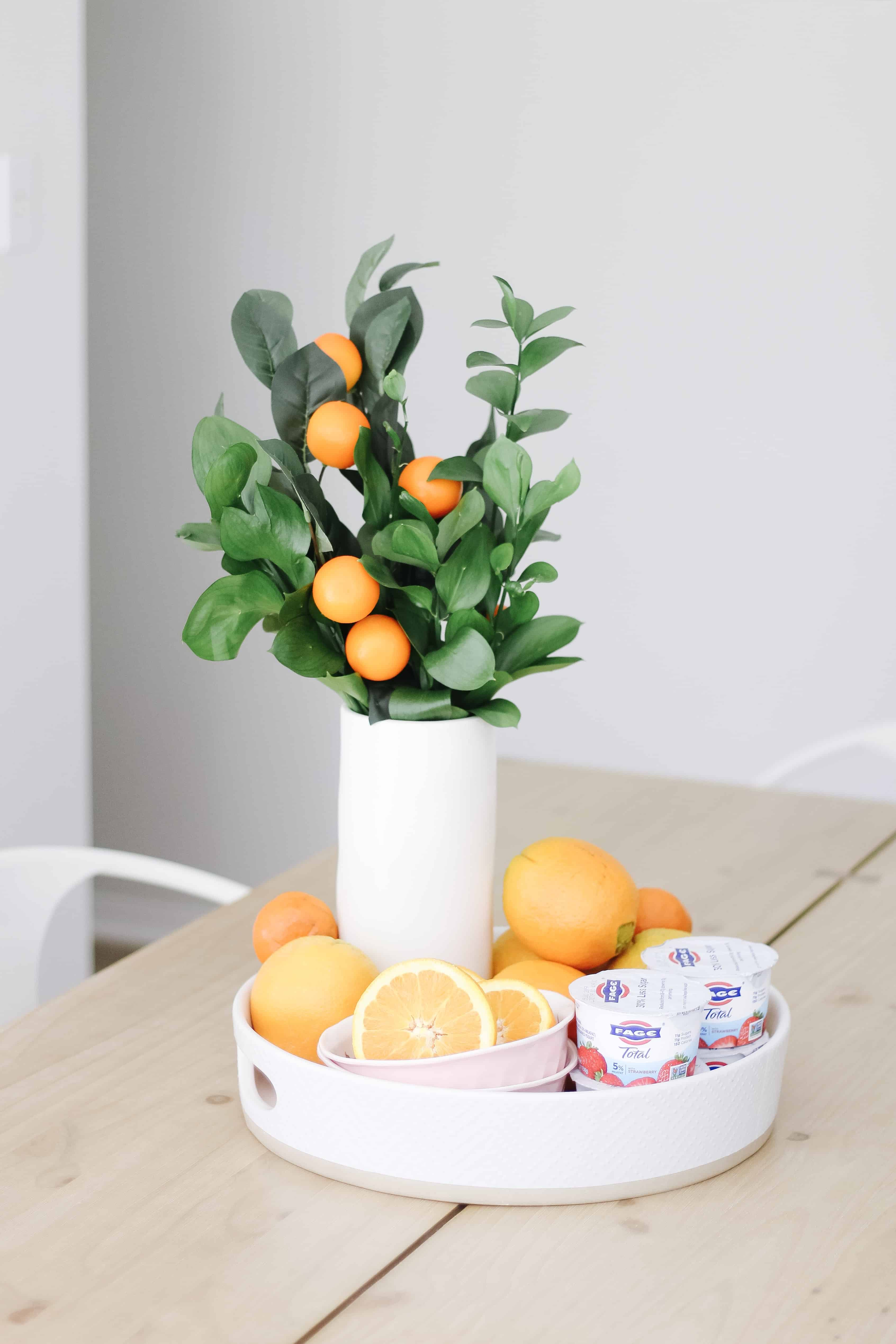 Fage yogurt and oranges in vase