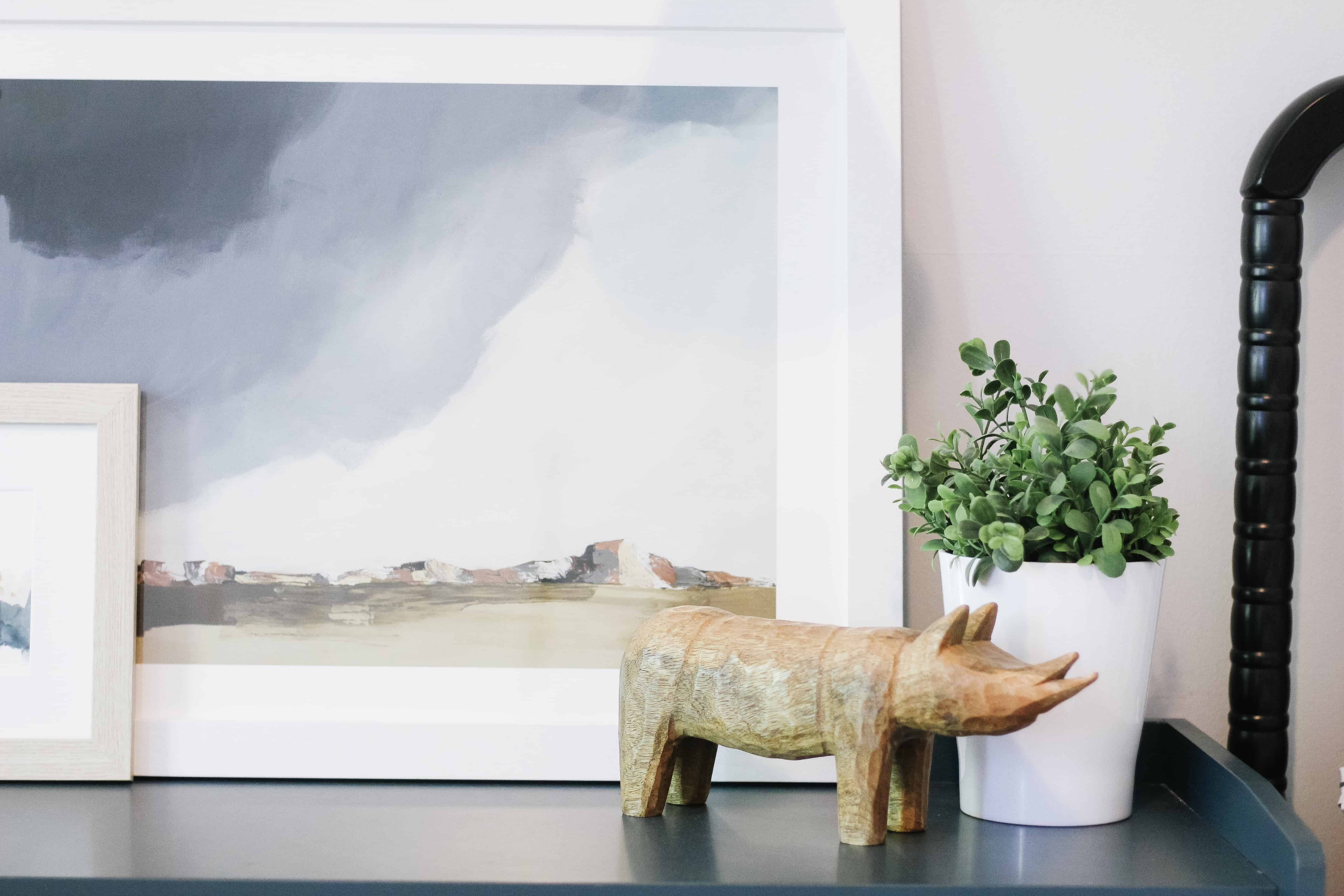 modern dresser decor of print and wooden animal