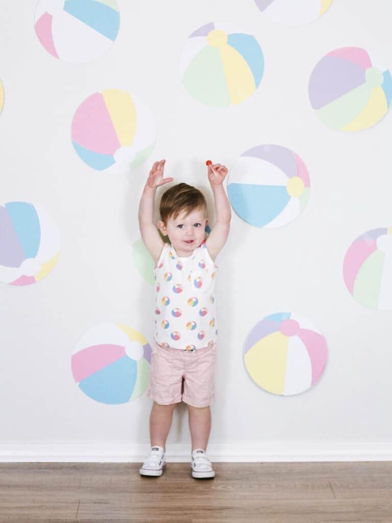 2 year old boy with beach ball decor