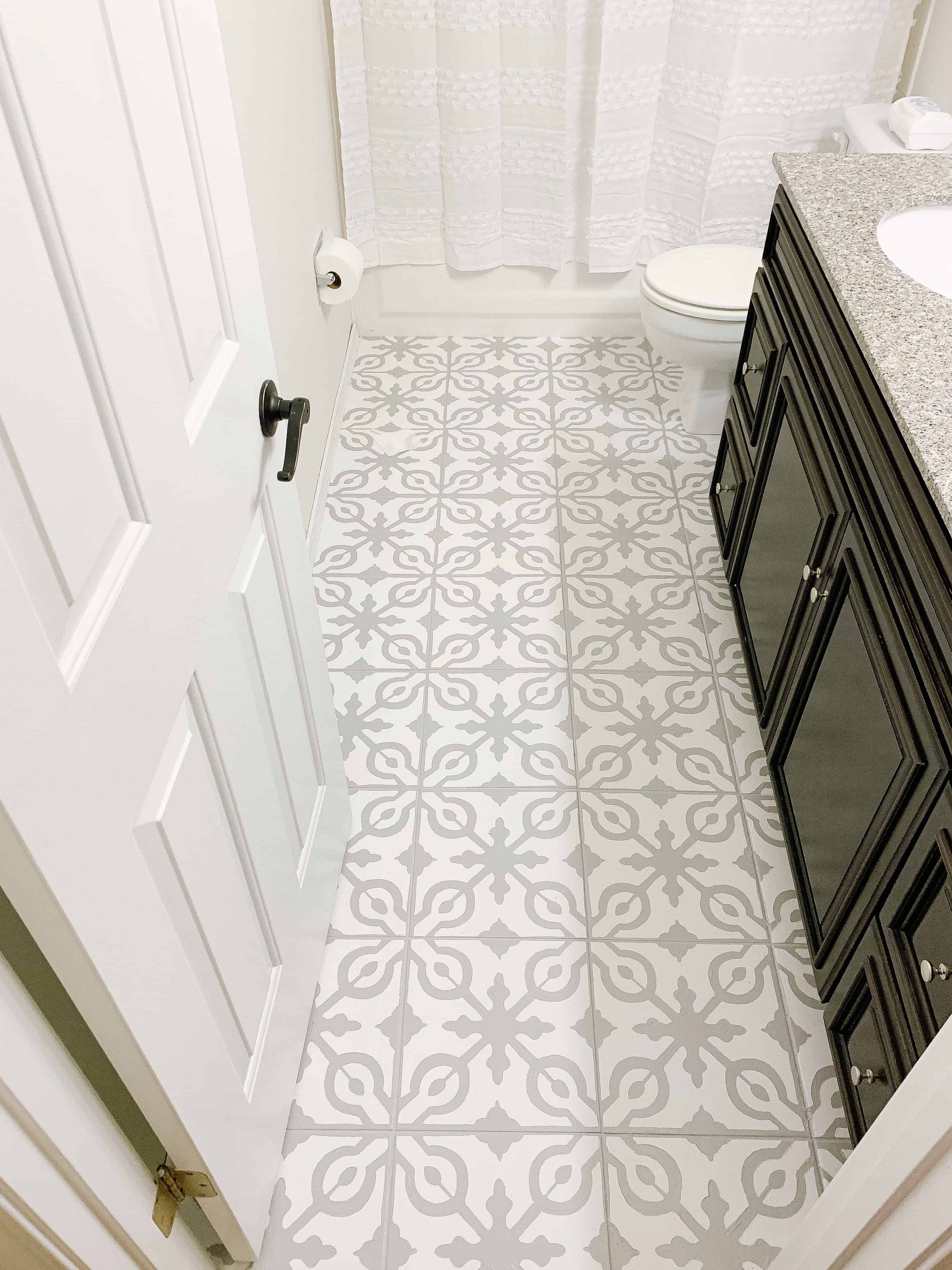 View of painted tile floor grey and white