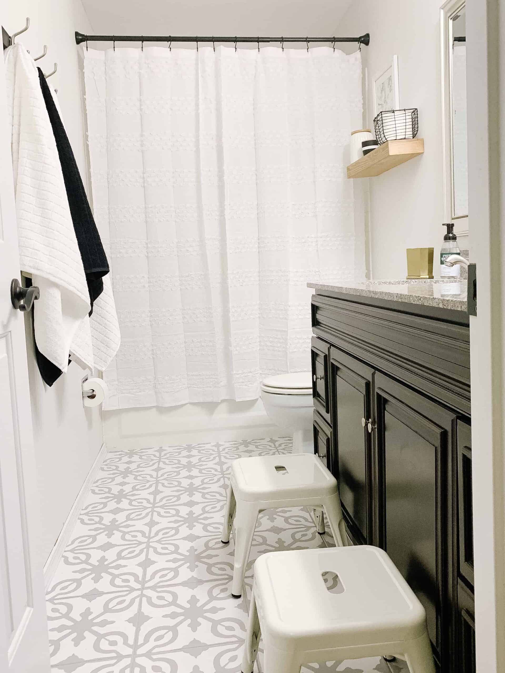 Bathroom with painted tile floors