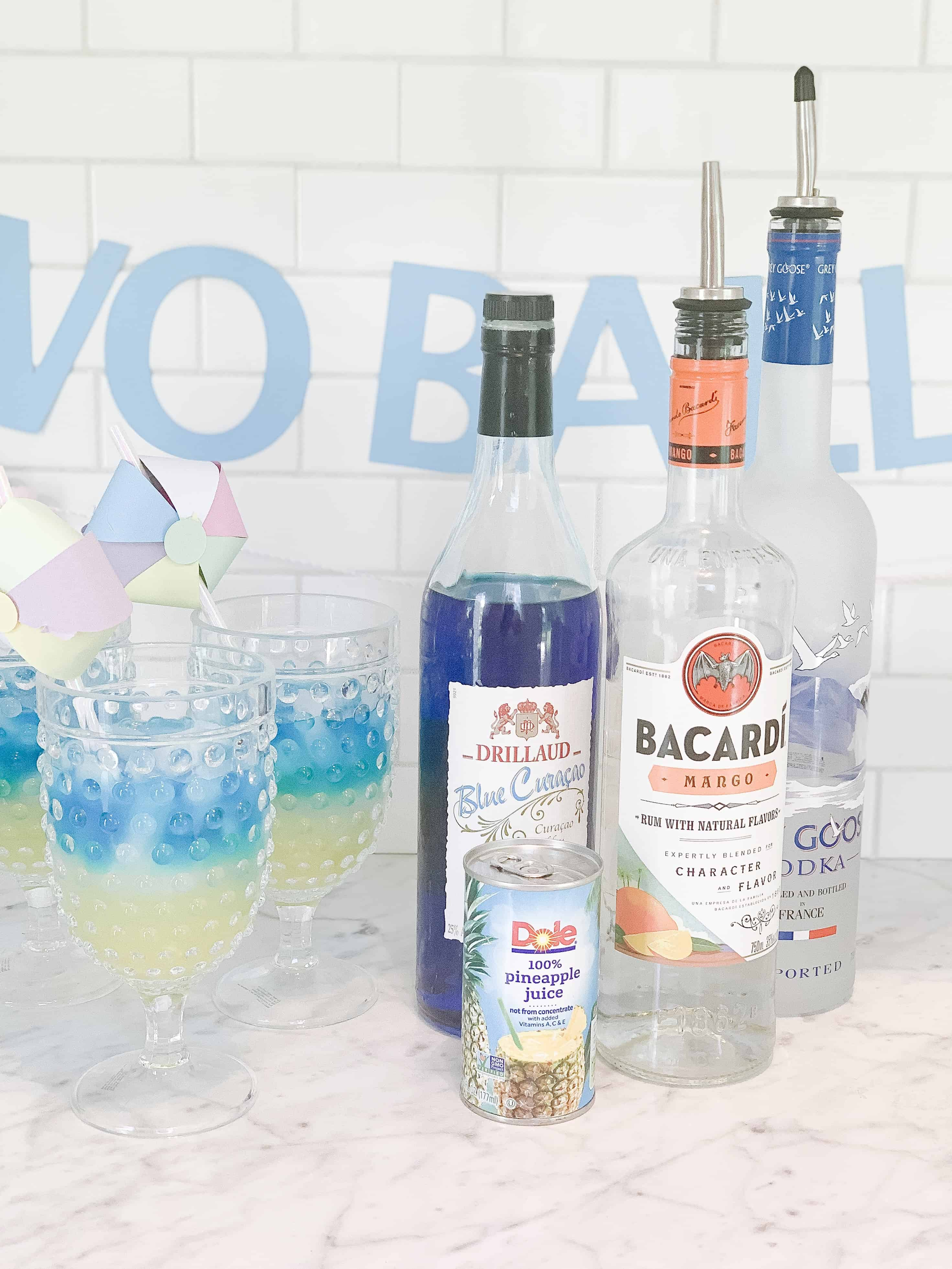 ingredients for blue and yellow cocktail