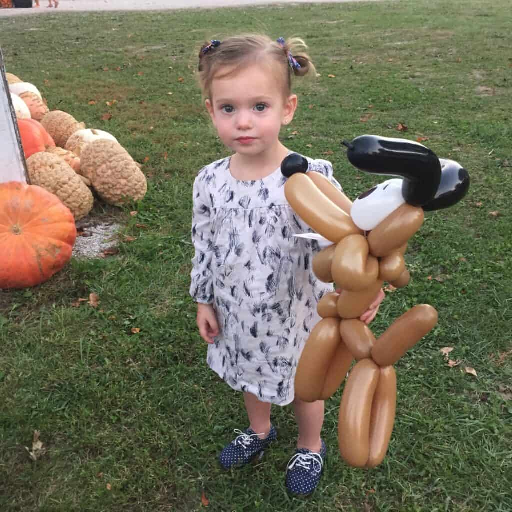 two year old girl with balloon animal
