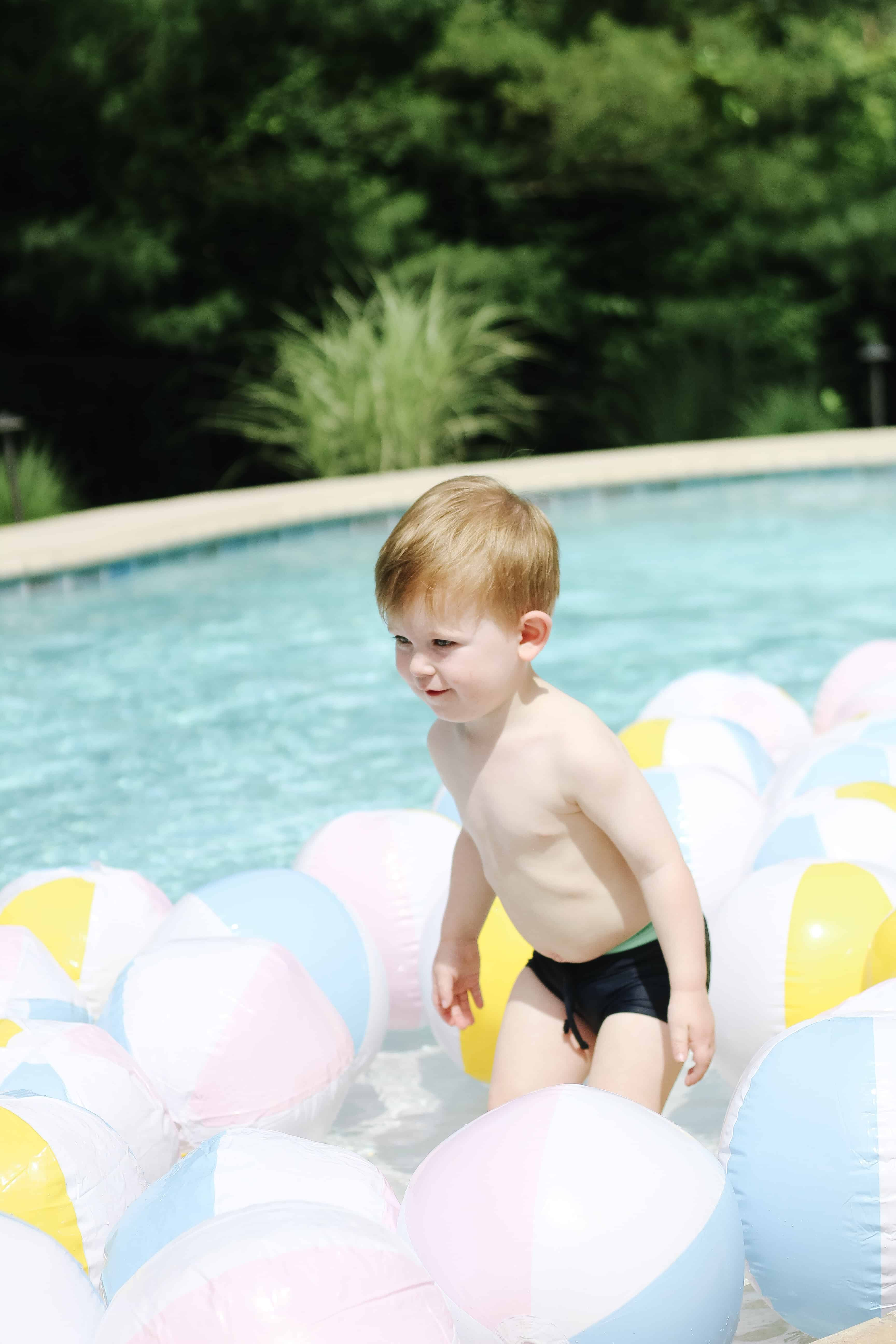 Beach ball's and a toddler in pool