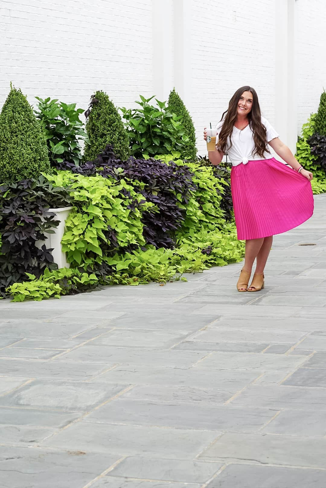 Blogger photo in pink skirt and white shirt