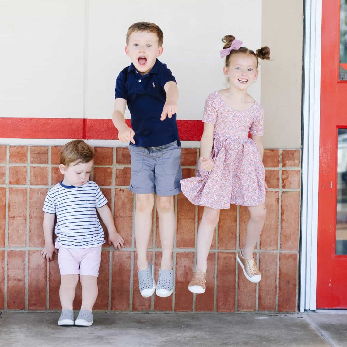 Kids jumping in front of Chuck E. Cheese