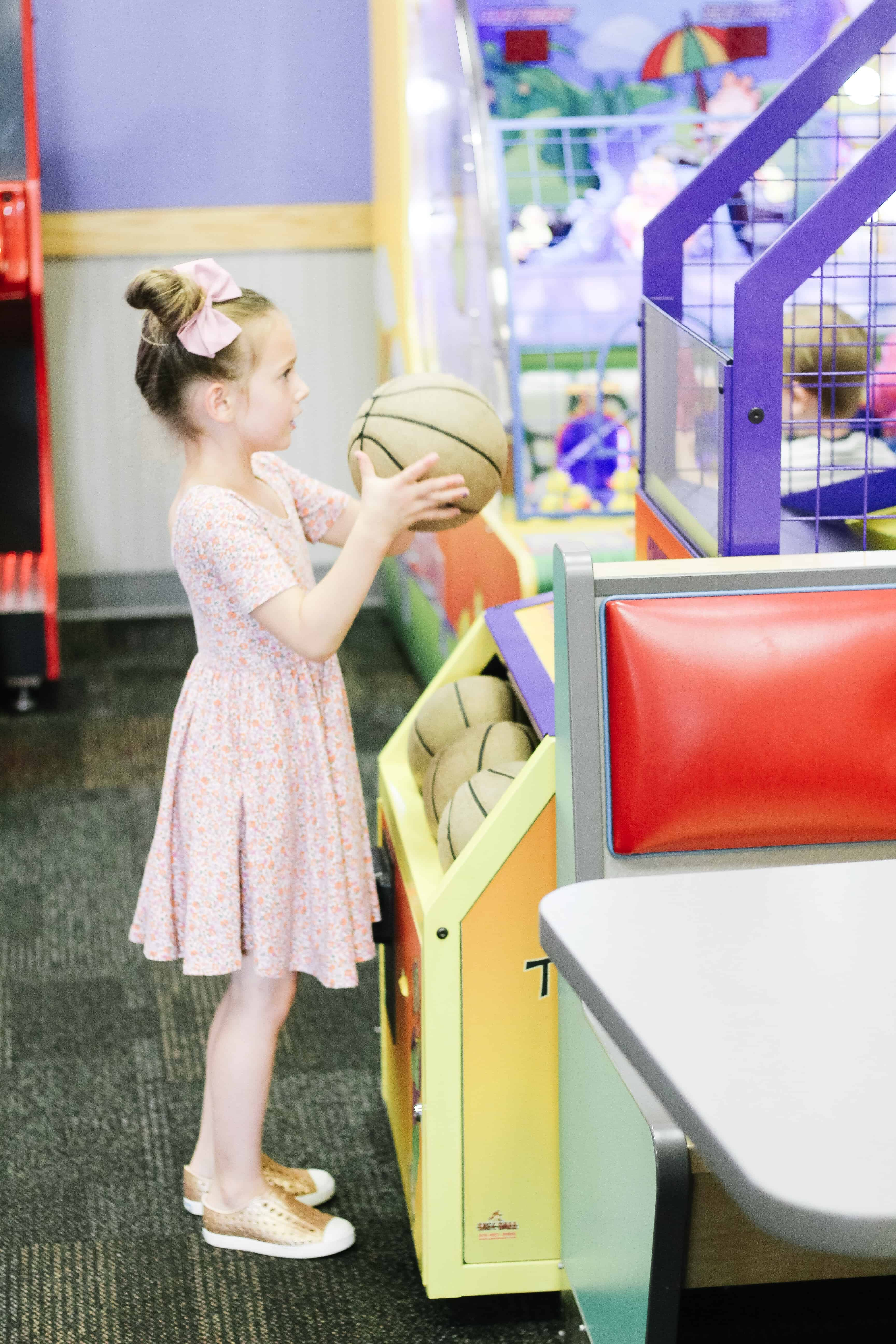 Toddler Playing Chuck E. Cheese Games