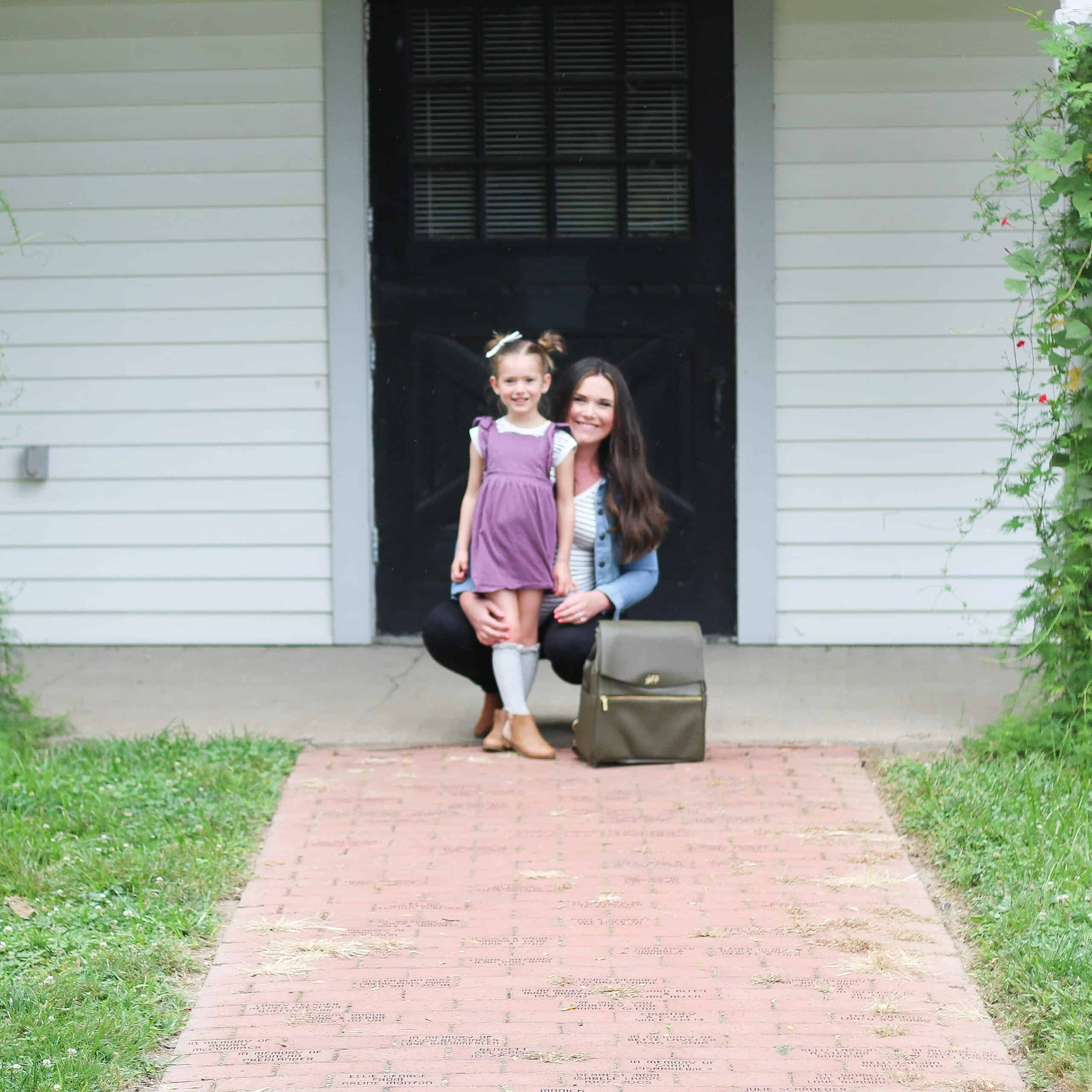 toddler girl and mom with freshly picked diaper bag