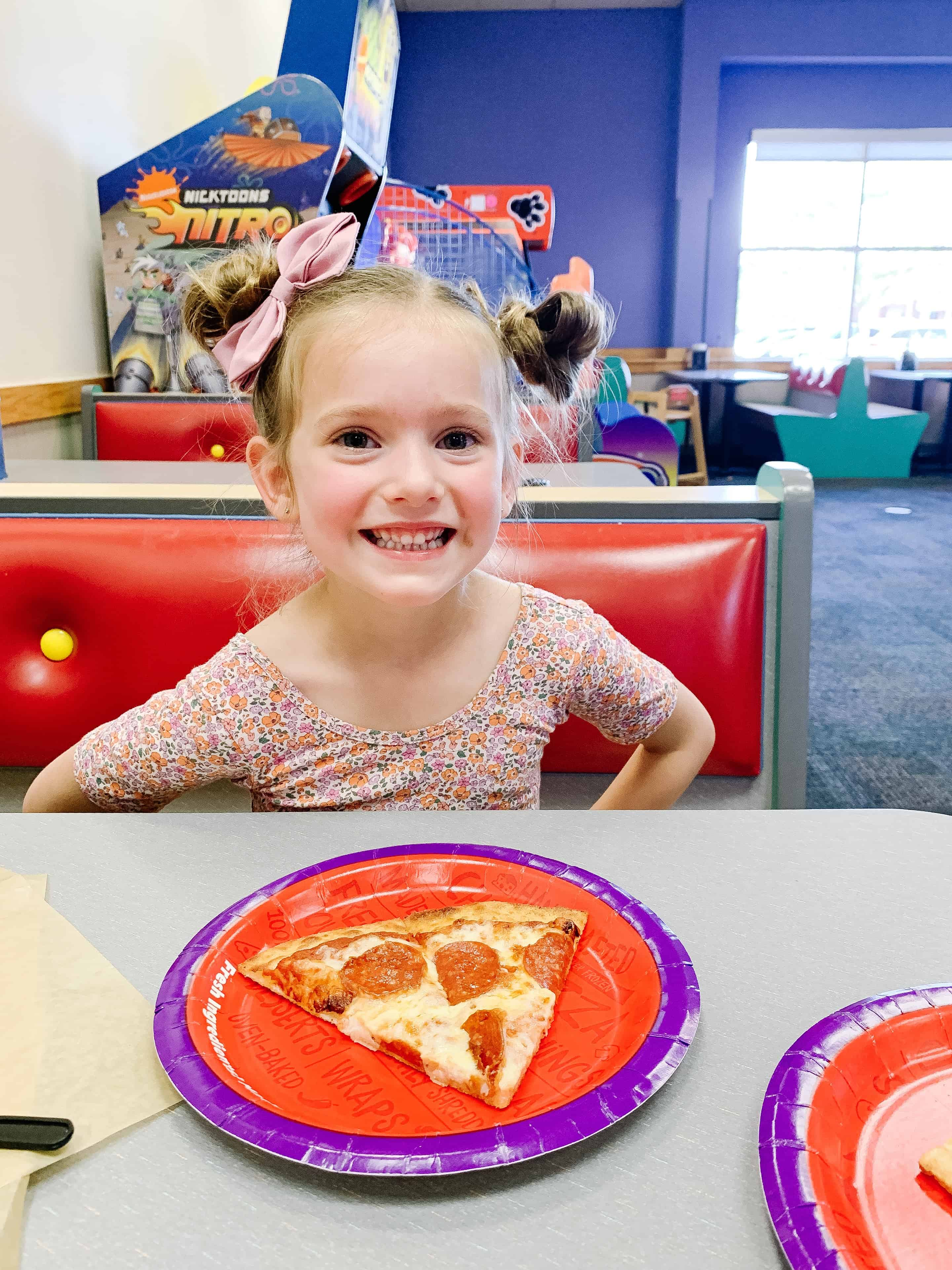 Chuck E. Cheese pizza and toddler girl