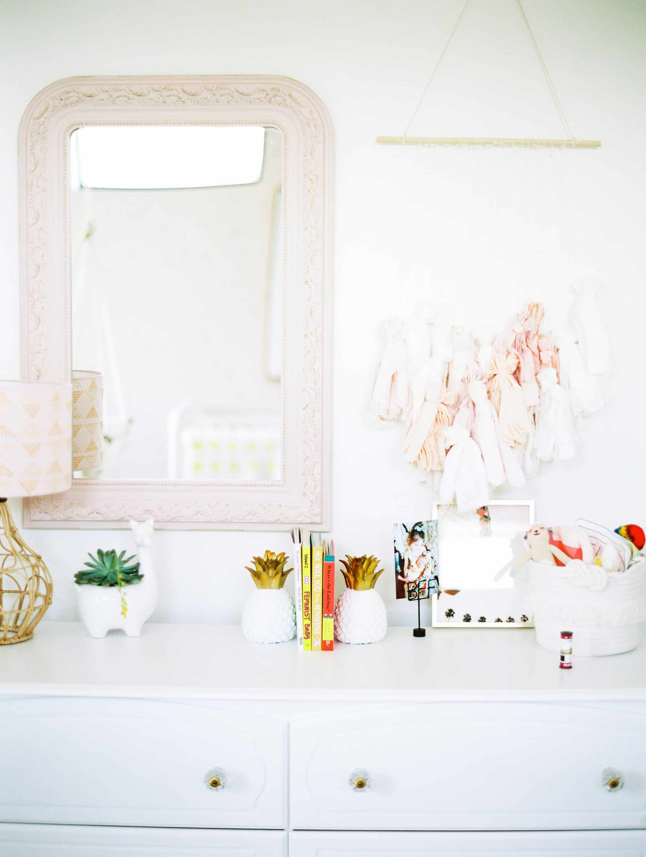 fun dresser in a pink boho nursery