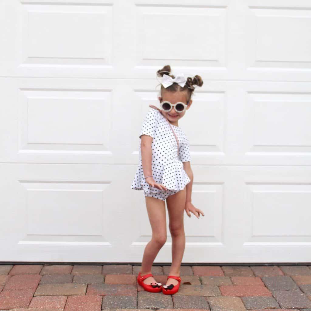 little girl in a cute toddler gymnastics leotard