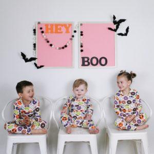 3 kids in matching halloween pajamas