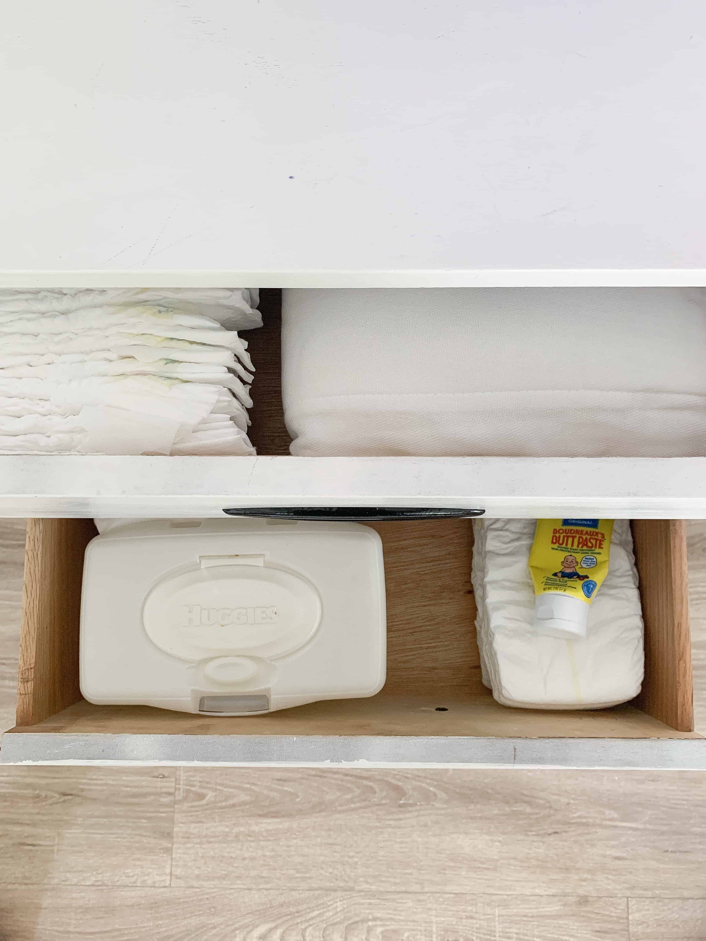 Entertainment Center drawer with baby essentials