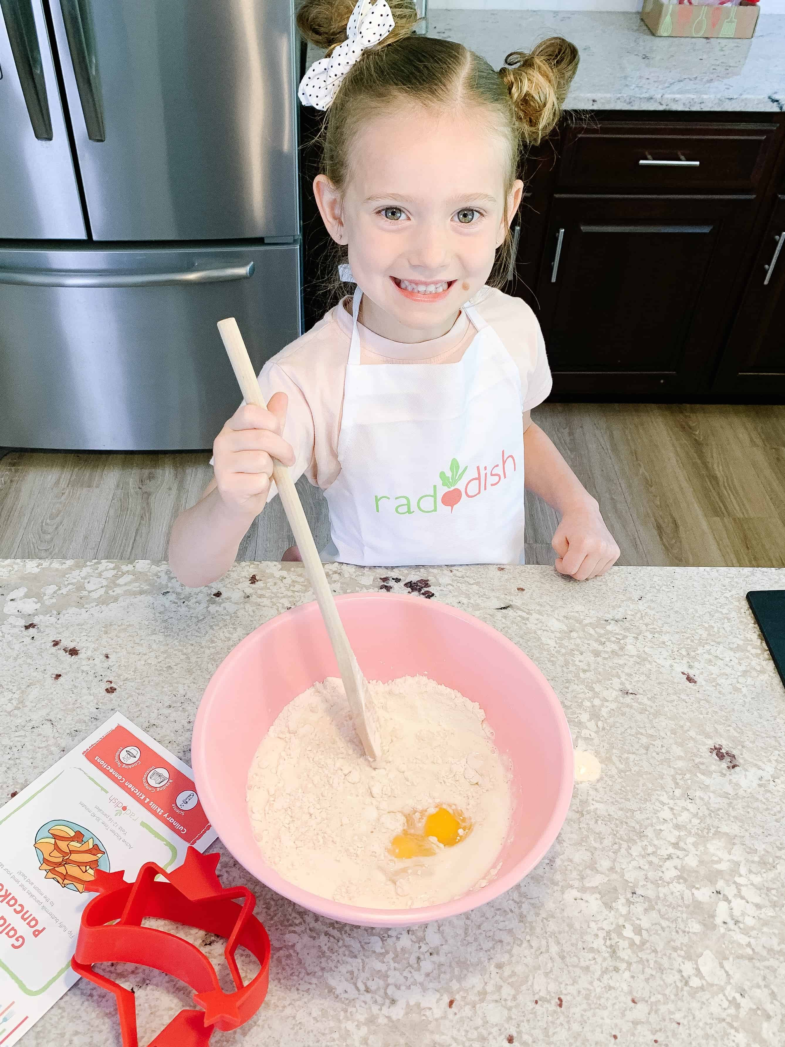 Little Girl cooking Raddish Kids kit