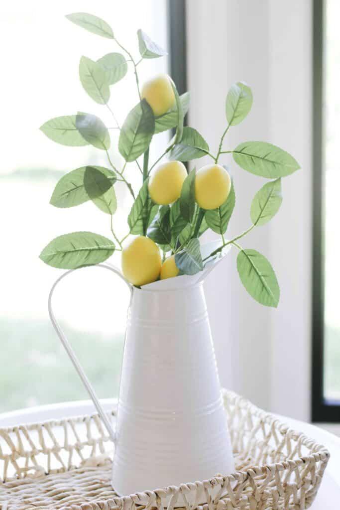 white vase with lemon Stems