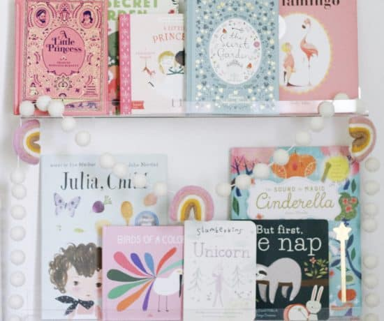 clear book ledges with children's books.