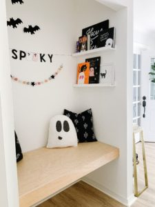 book nook with Halloween books and decor