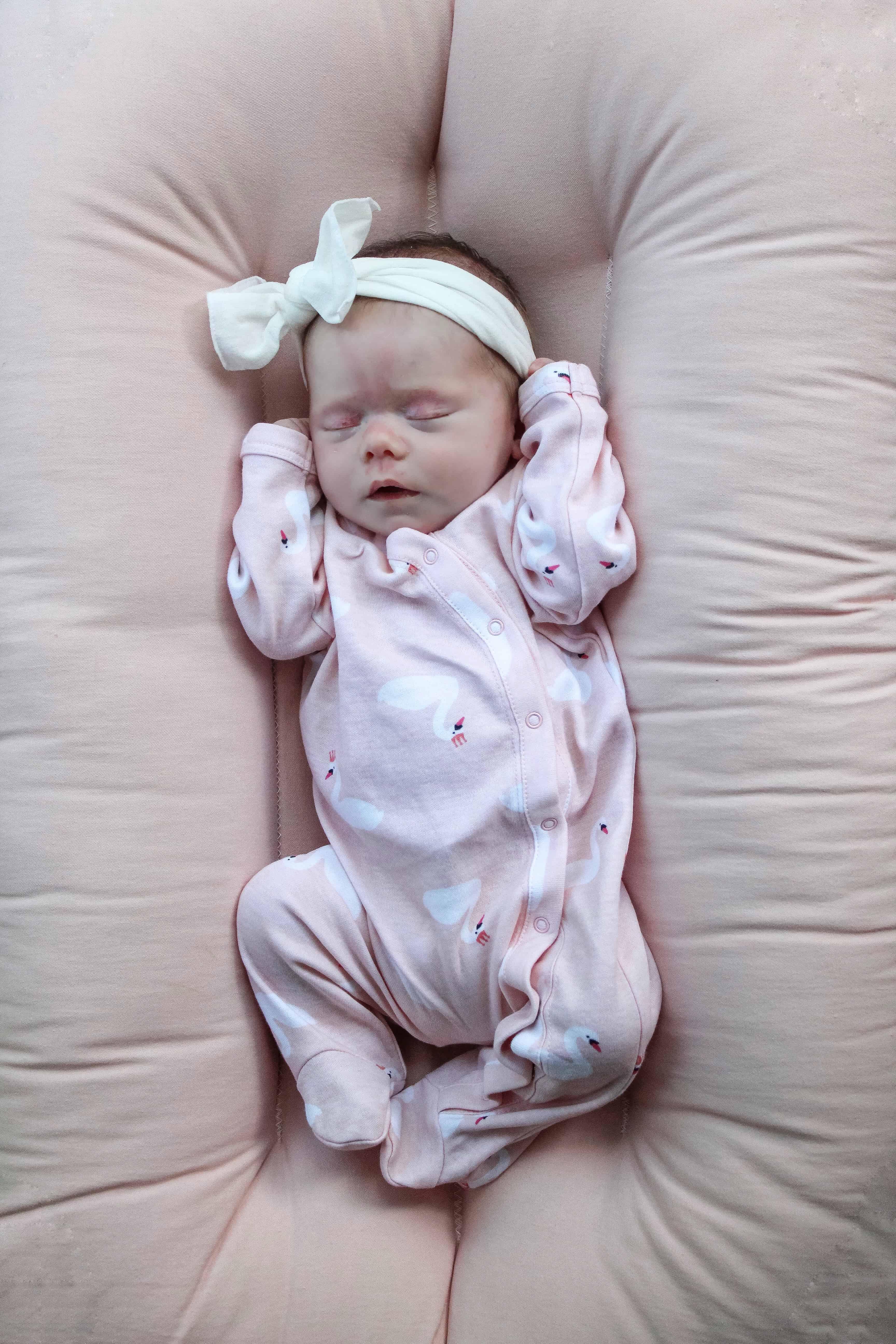Sleeping baby in snuggle me organic