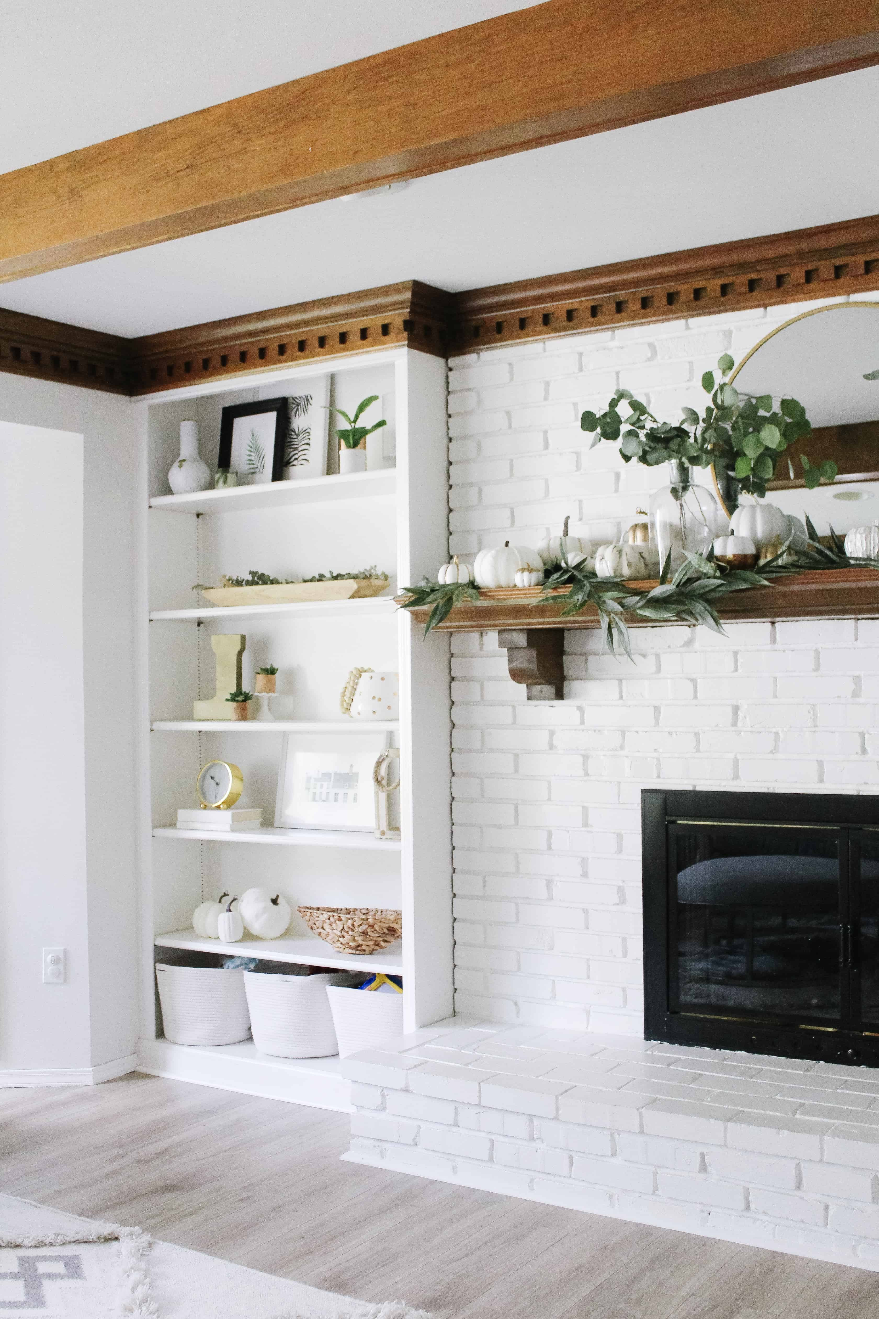 White mantle and built ins with fall decor