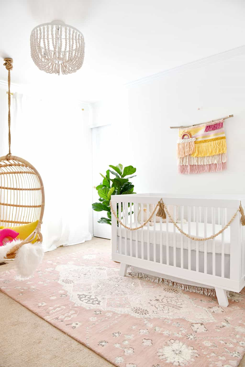 Baby nursery with rainbow and pink accents