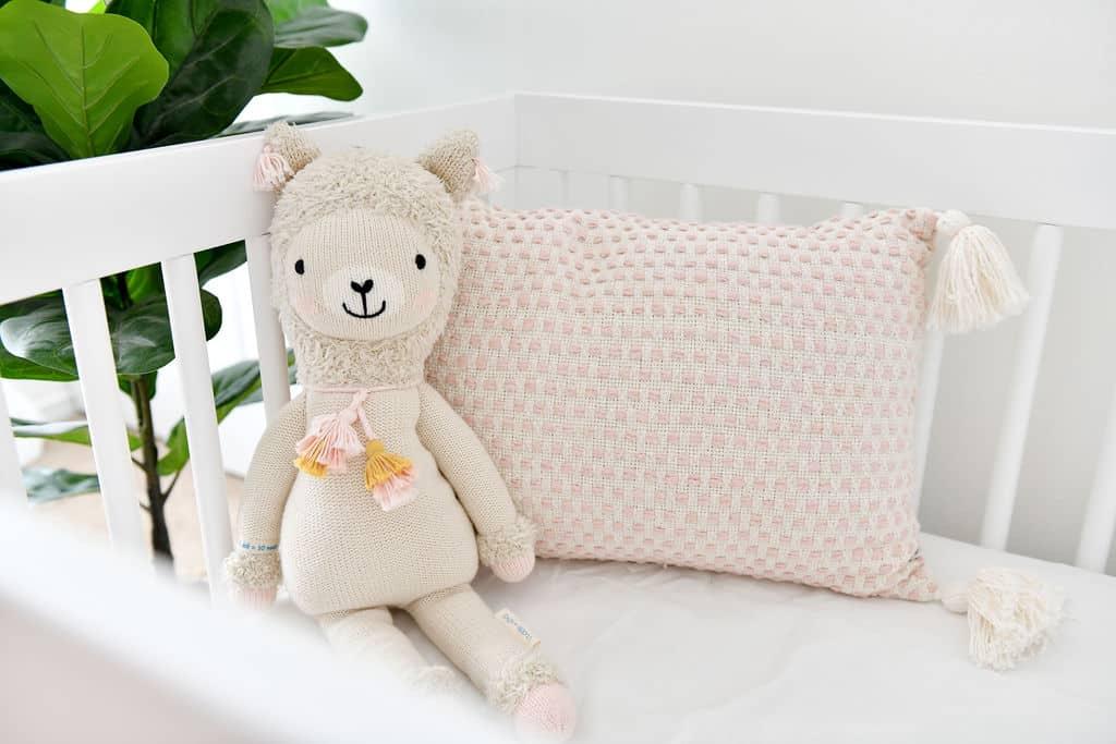 Cuddle and Kind Llama in crib