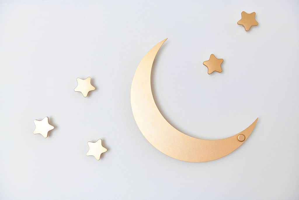 gold star and moon hooks on wall