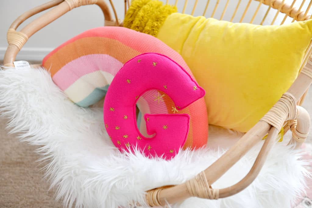 Rattan Chair with rainbow and G pillows