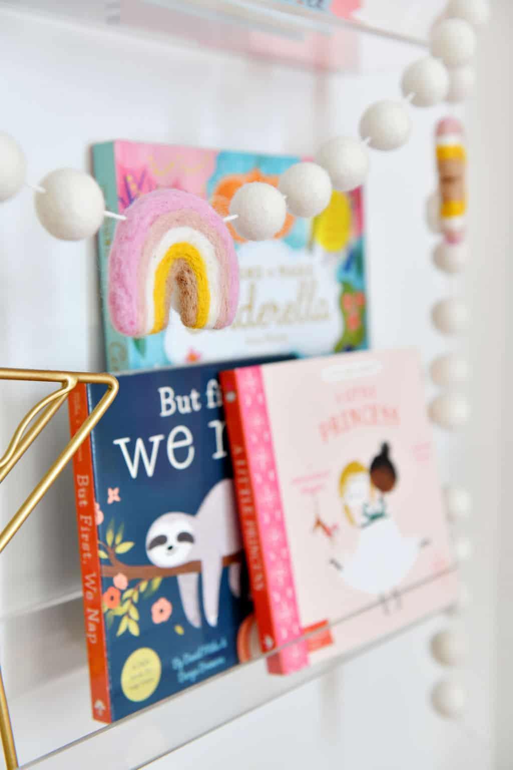 Rainbow felt banner on bookshelves