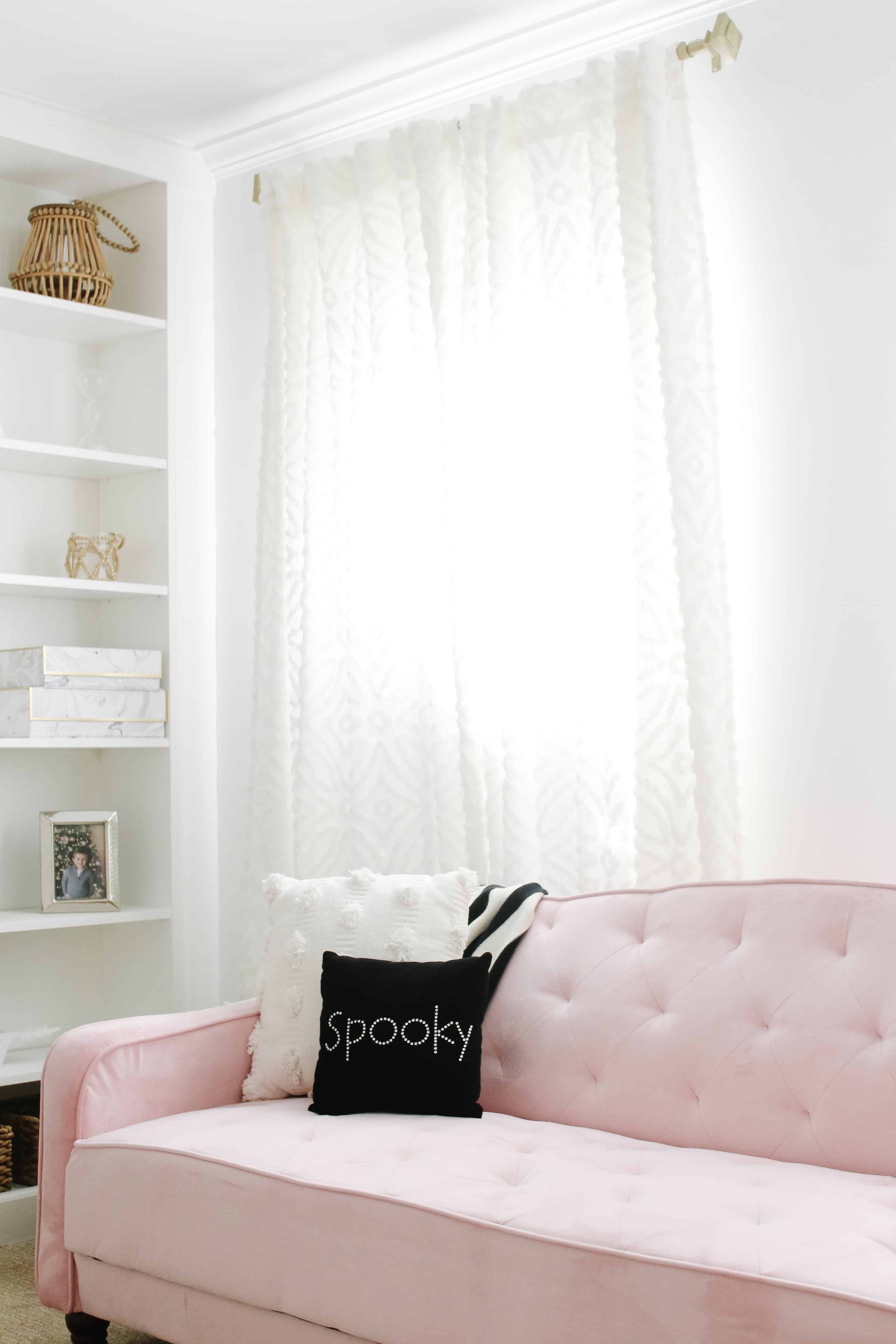 pink couch with Halloween pillows
