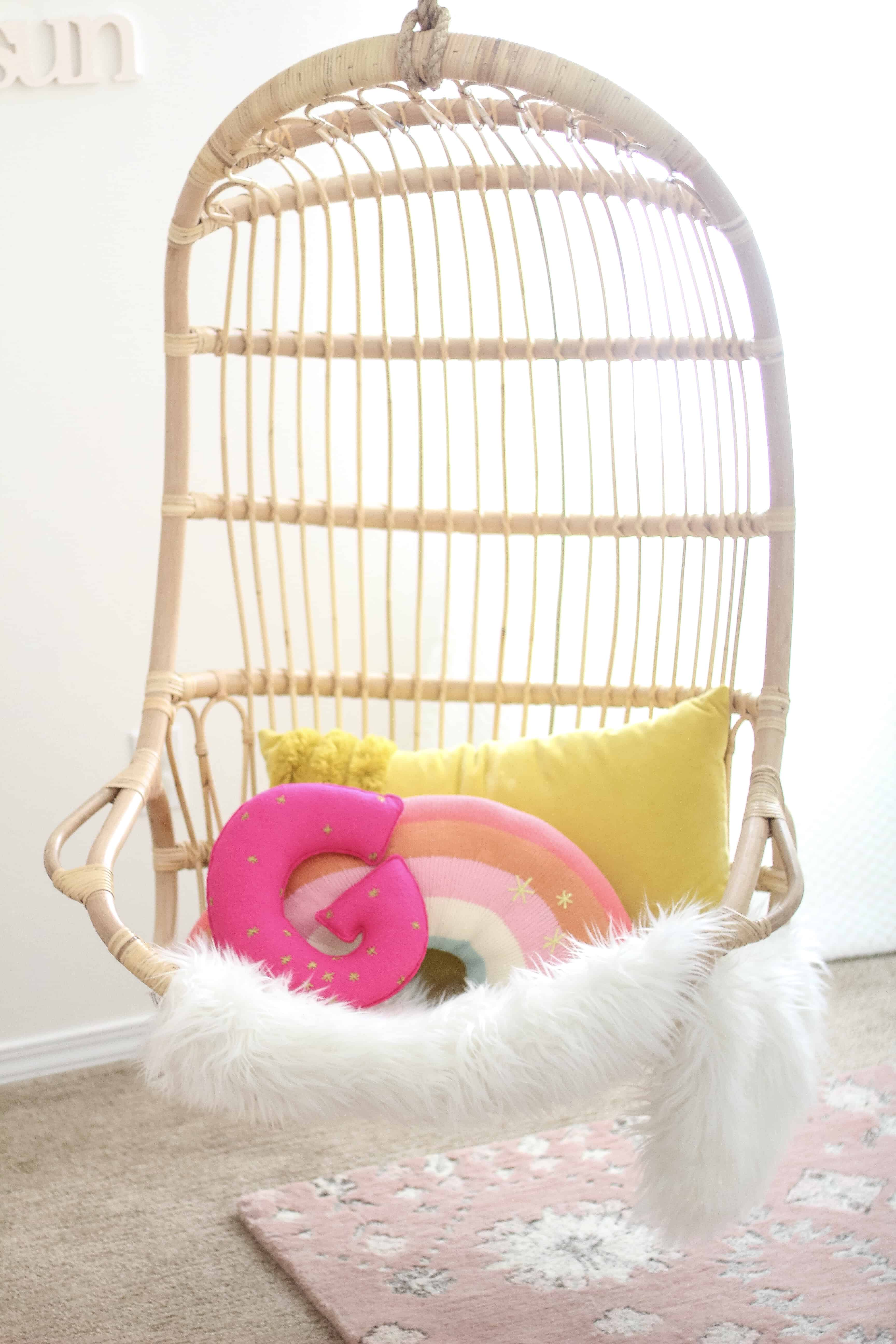Hanging Serena and lily chair with rainbow and G pillow
