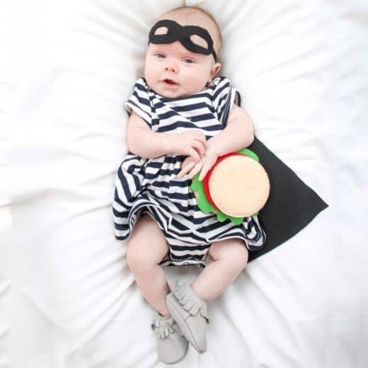 Baby girl dressed as the hamburger