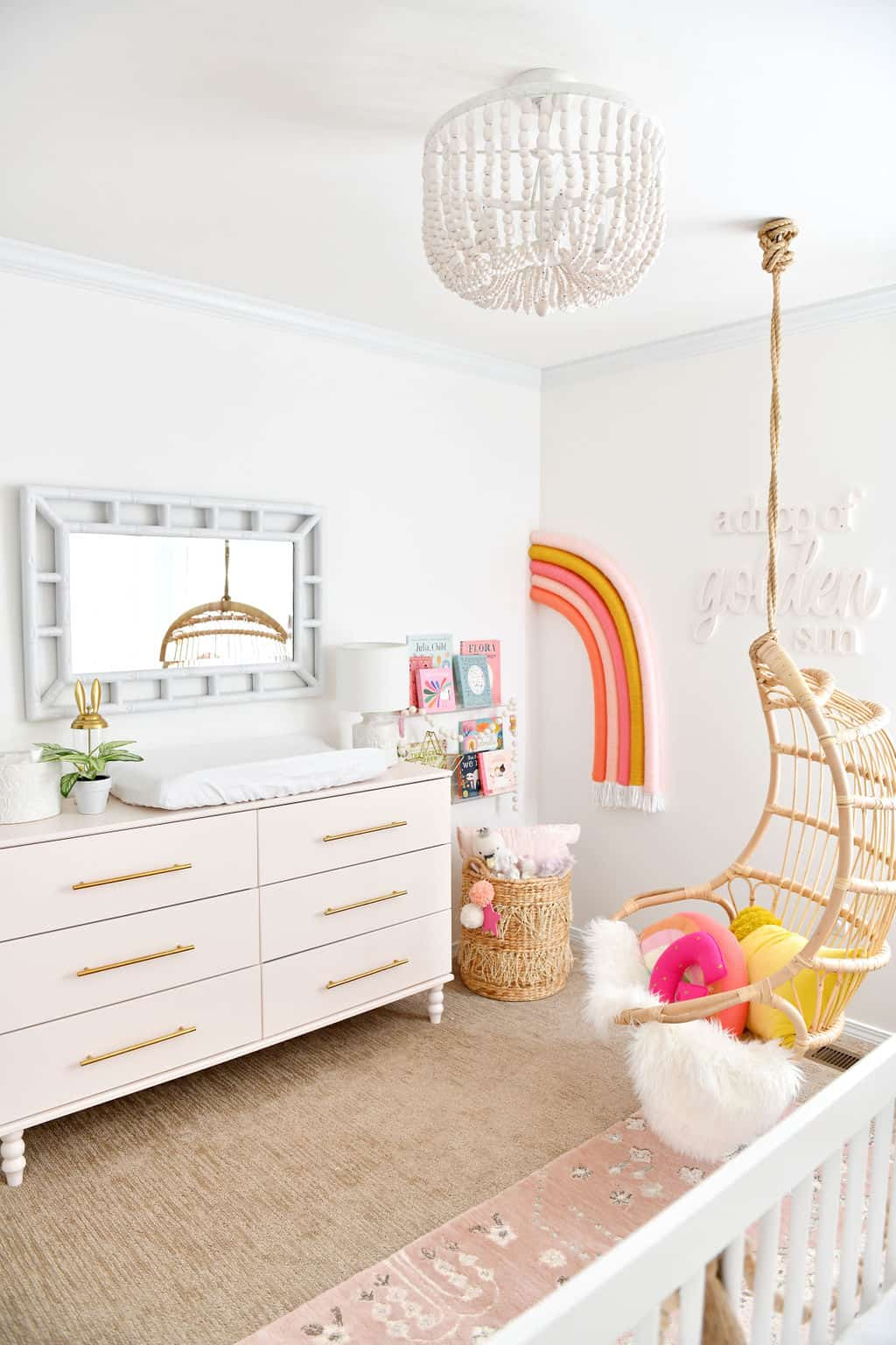 Pink Ikea dresser in room with rainbow