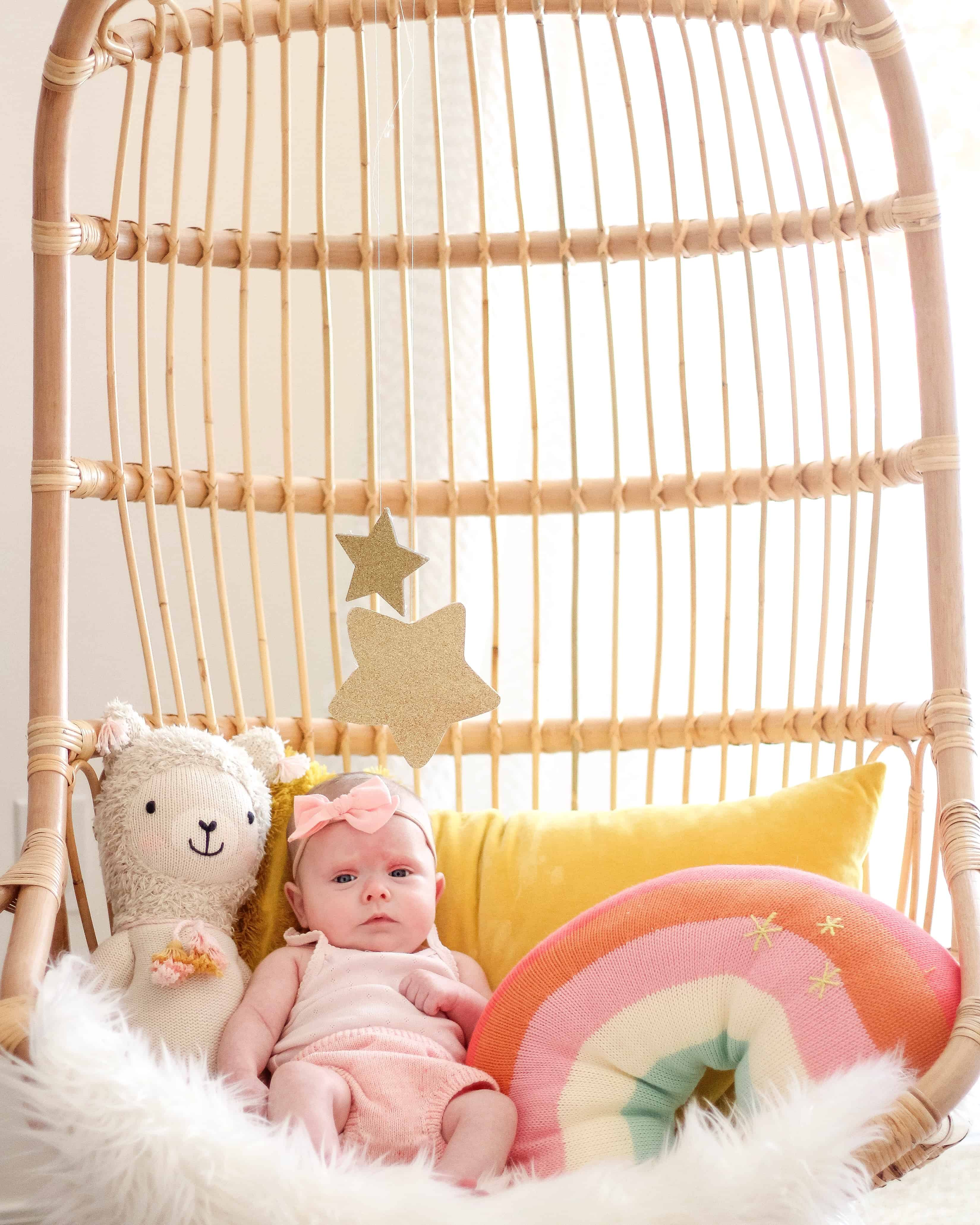 2 month old baby in Serena and lily chair