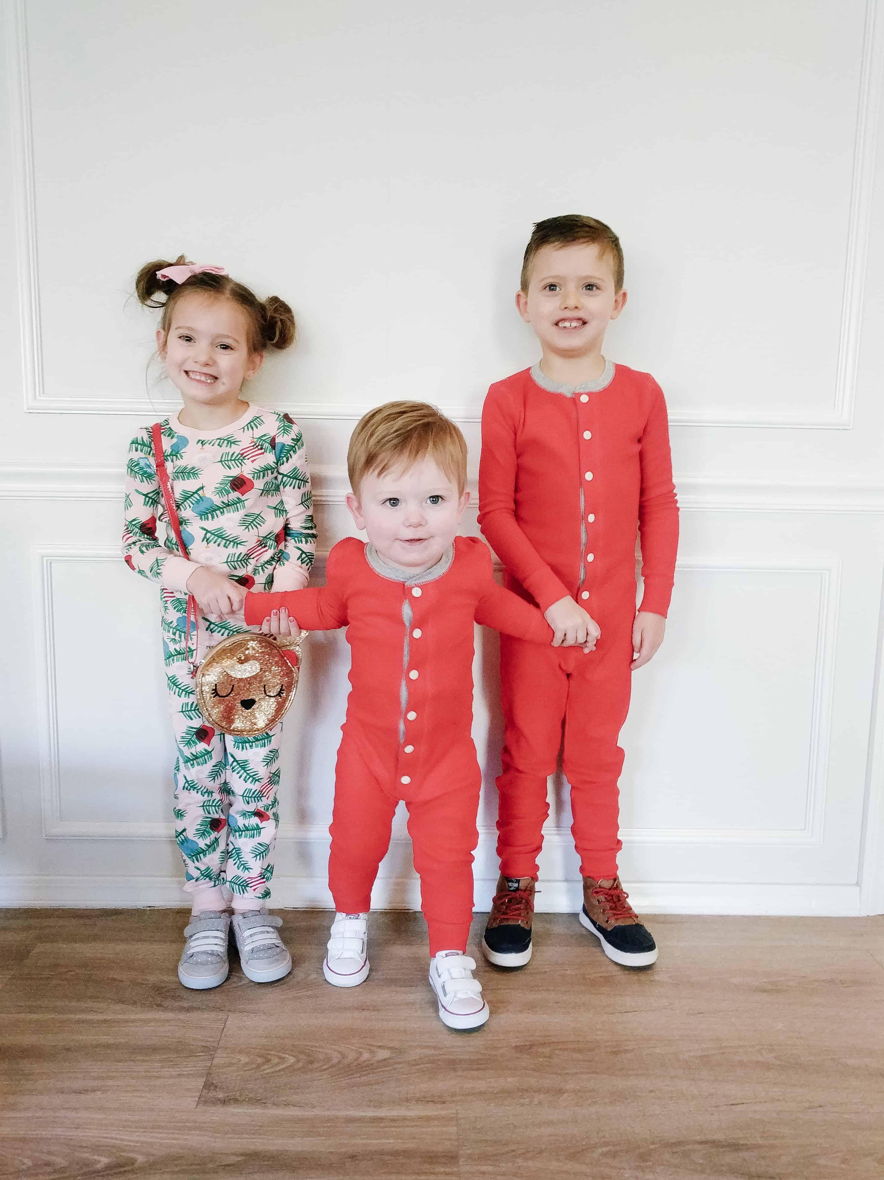Siblings in coordinating sibling Christmas Pajamas