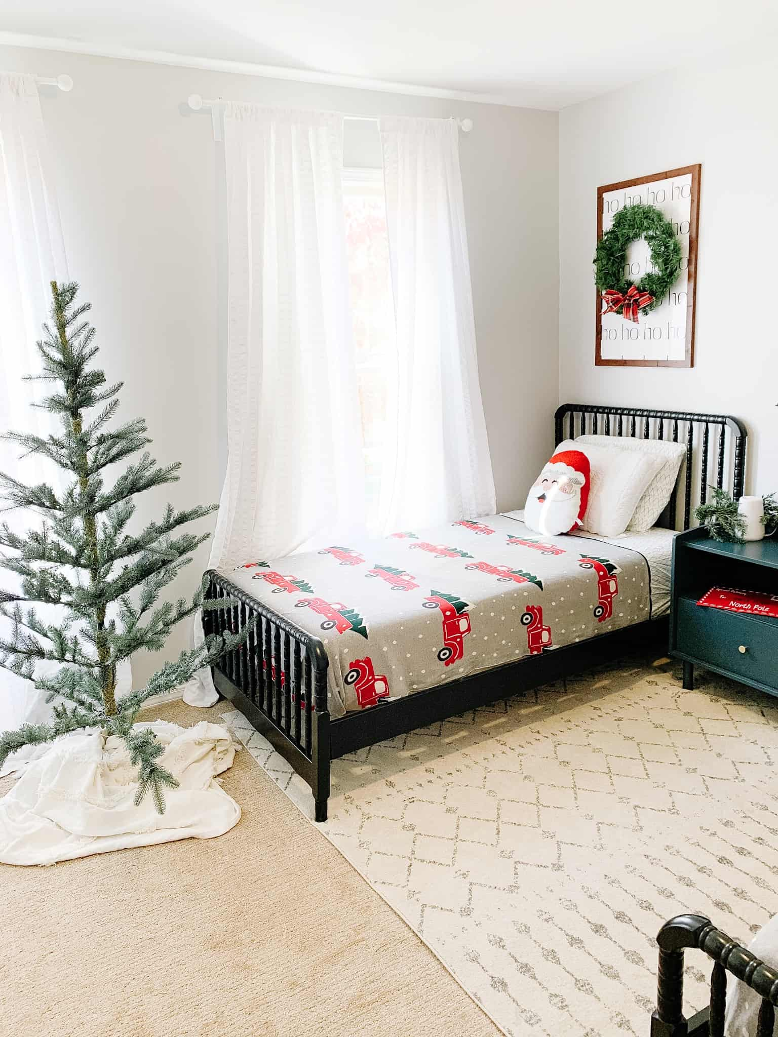 Boys room for Christmas with tree and Christmas Bedding