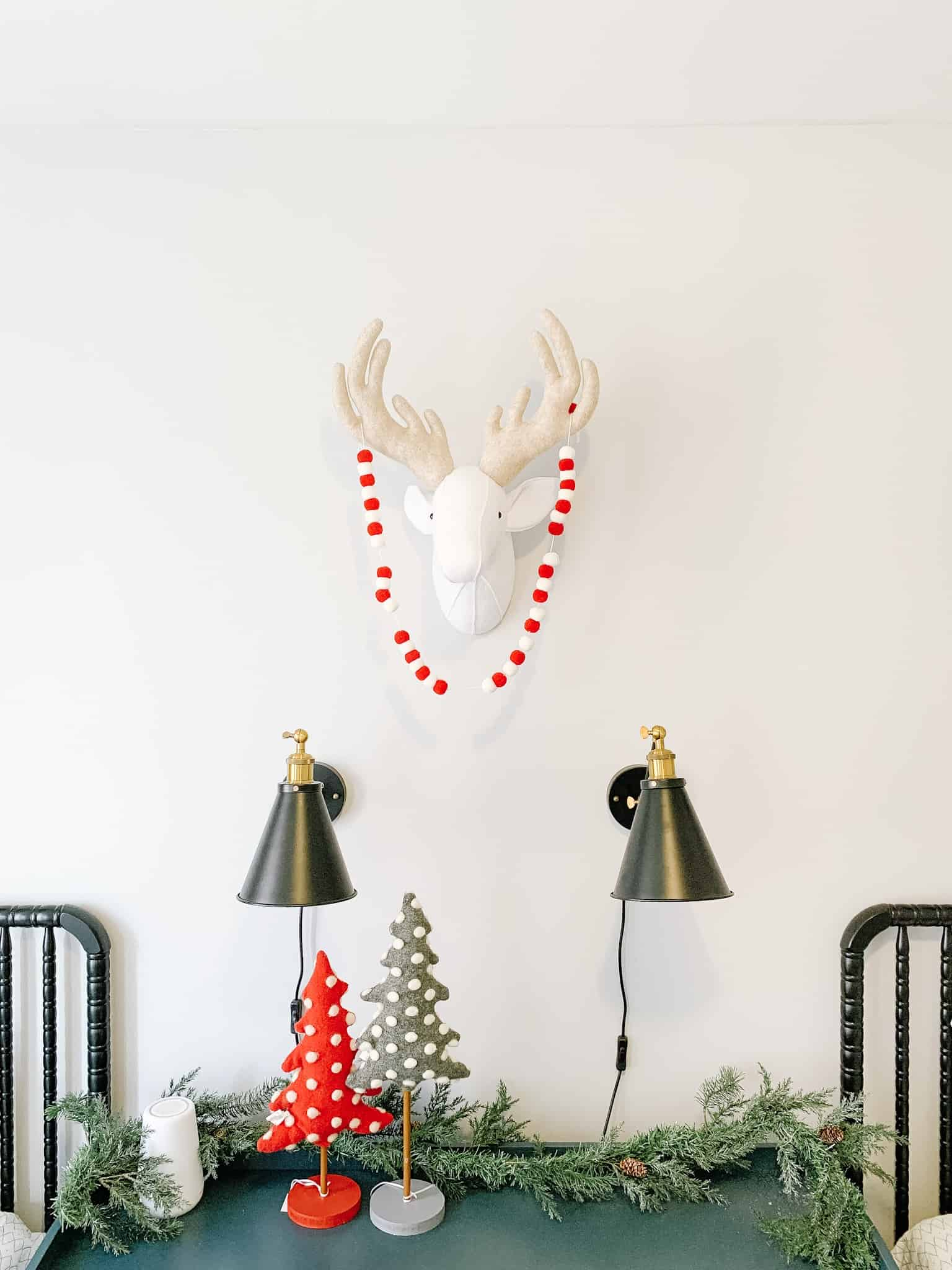 Wall in Boys room decorated with felt deer head and Christmas Garland