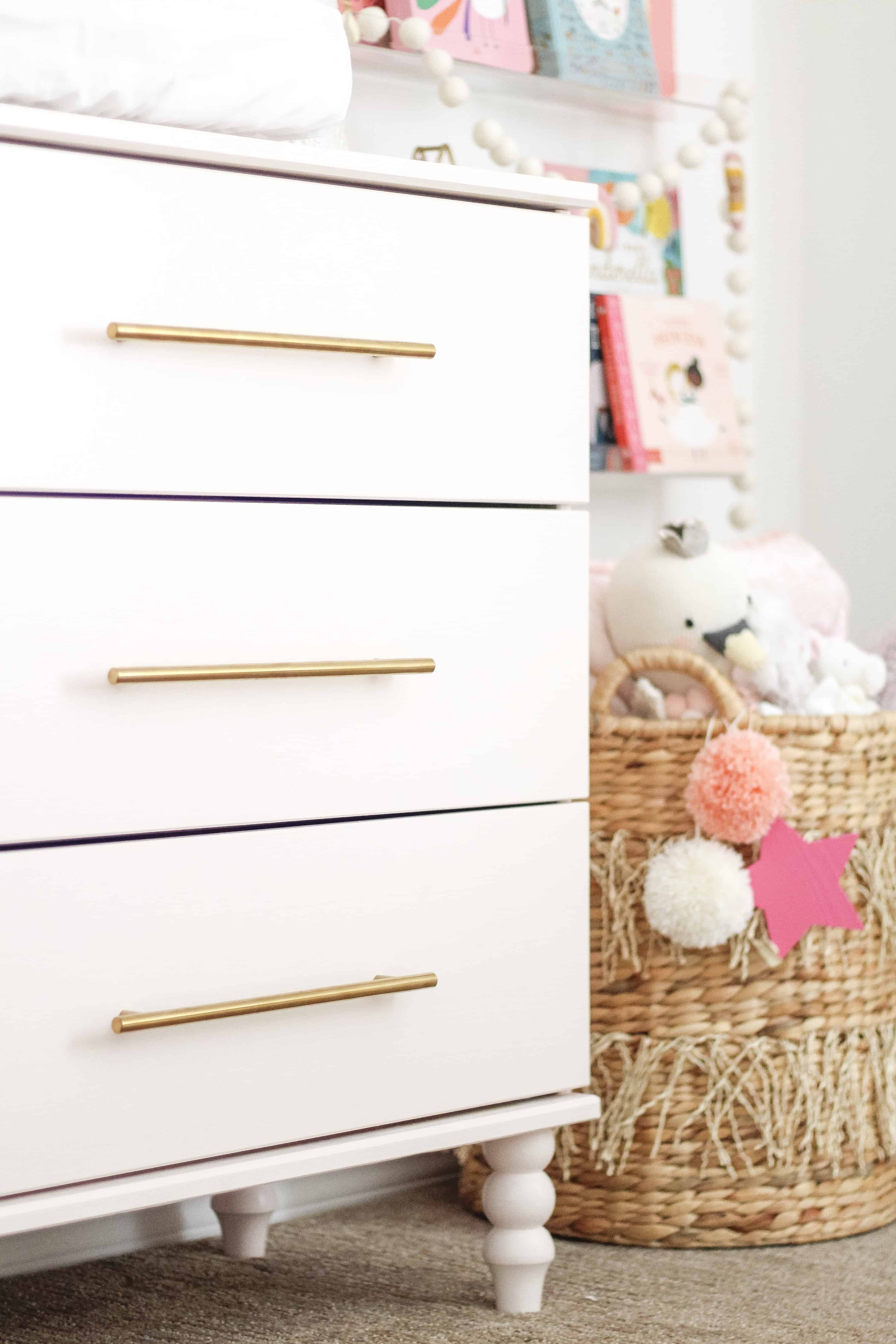 Pink IKEA dresser with gold drawer pulls