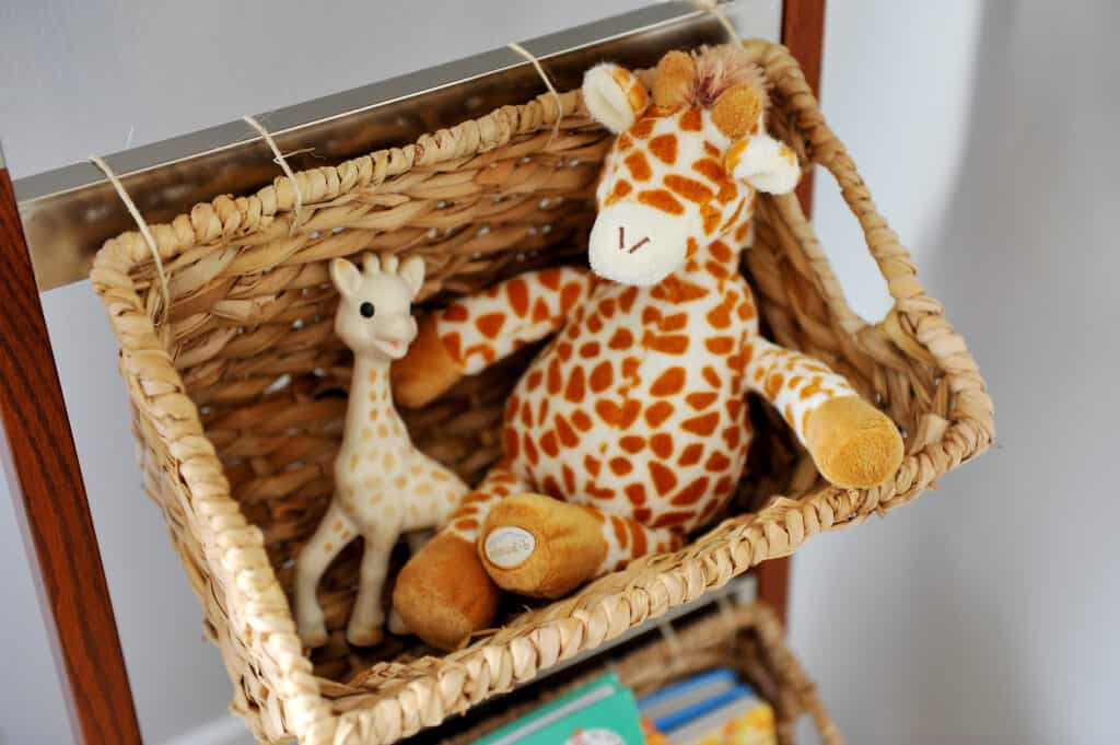 baskets with baby toy giraffes