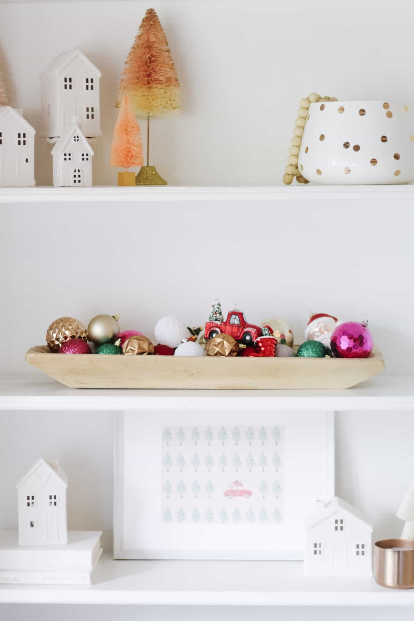 Wood bowl with ornaments on built in shelves