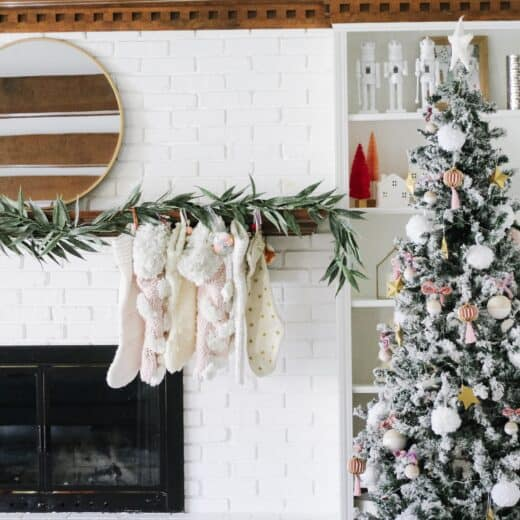 white mantle with stockings and modern garland