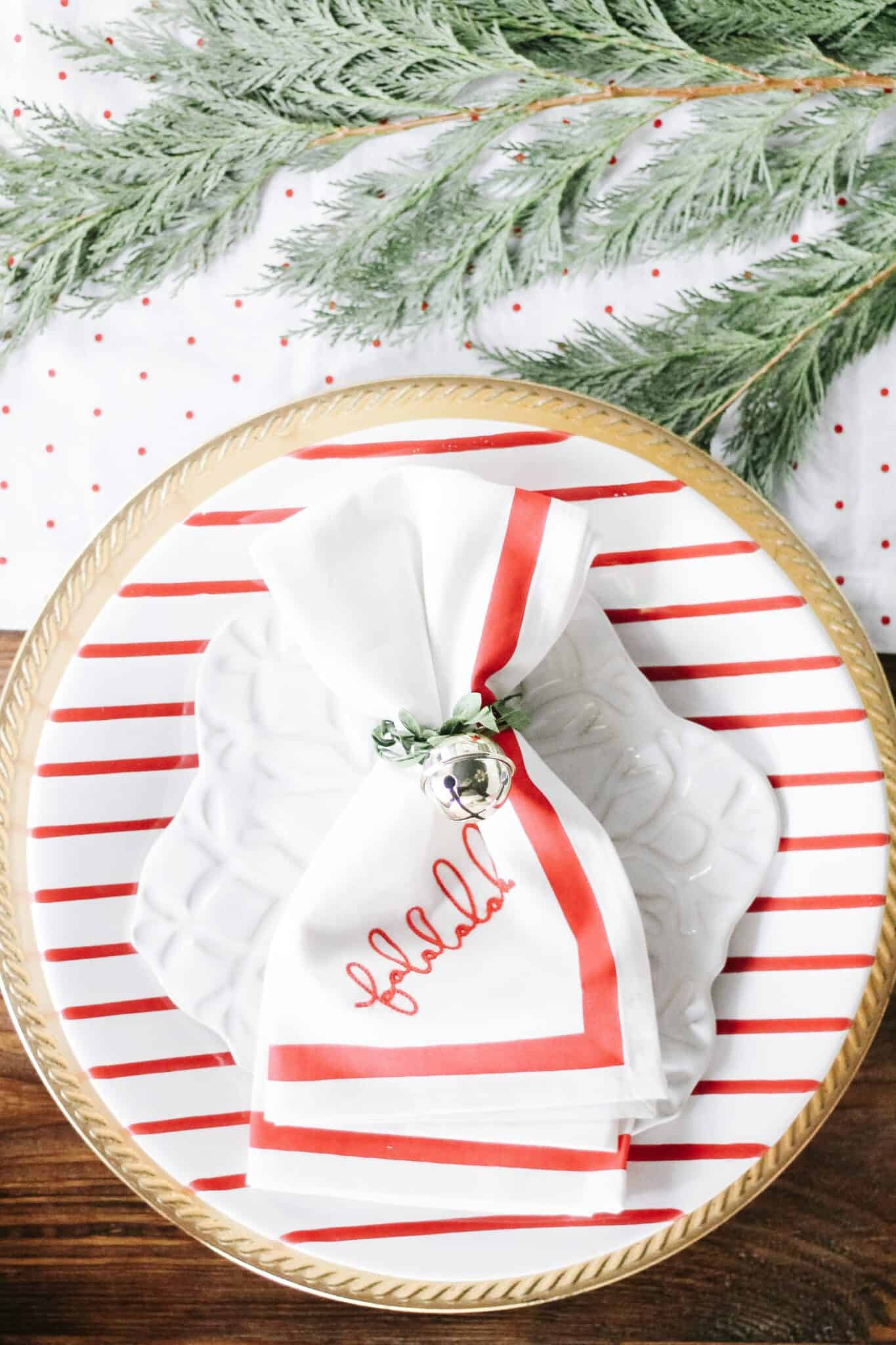 falala napkin on red striped candy cane plate