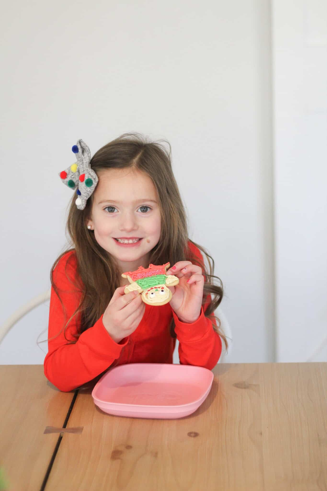 little girl eating a Christmas cookie