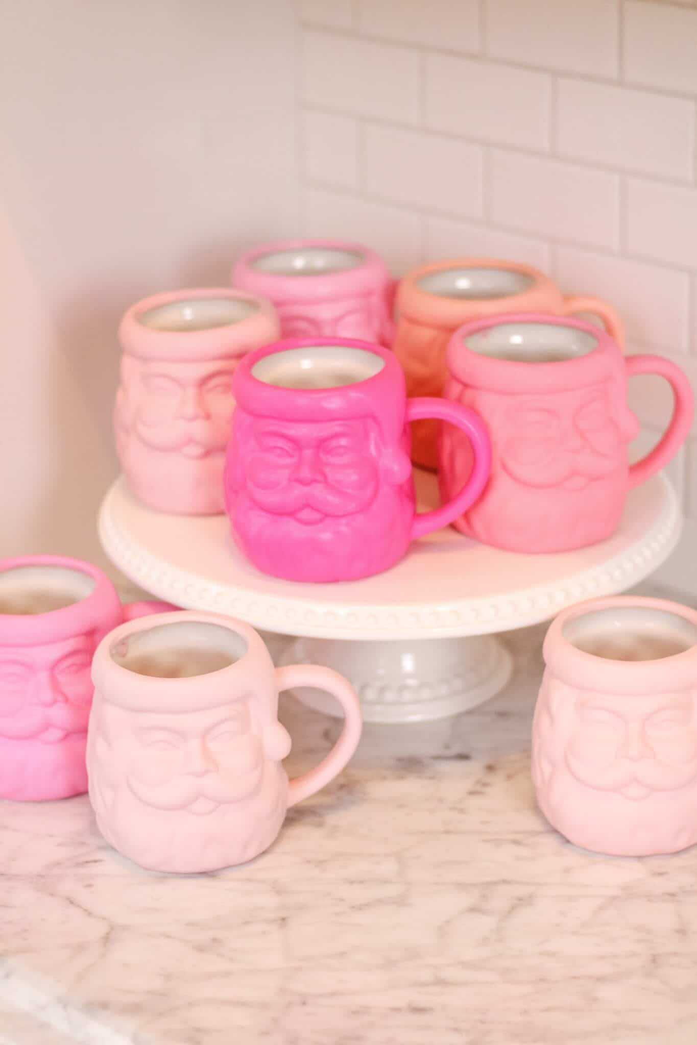 Pink Santa Mugs on a white cake stand