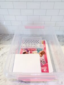 bin filled with craft supplies for kids