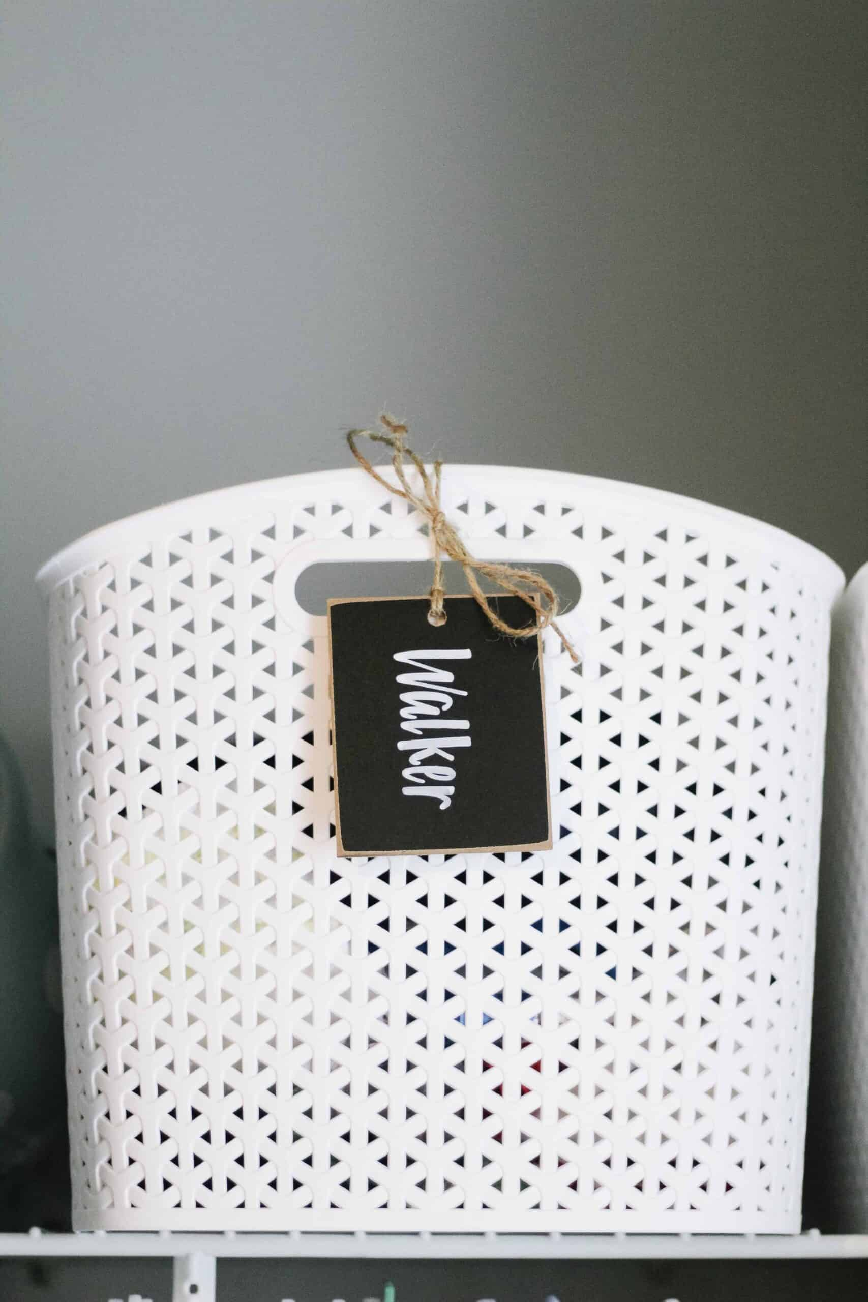 white plastic weave baskets with chalk name sign