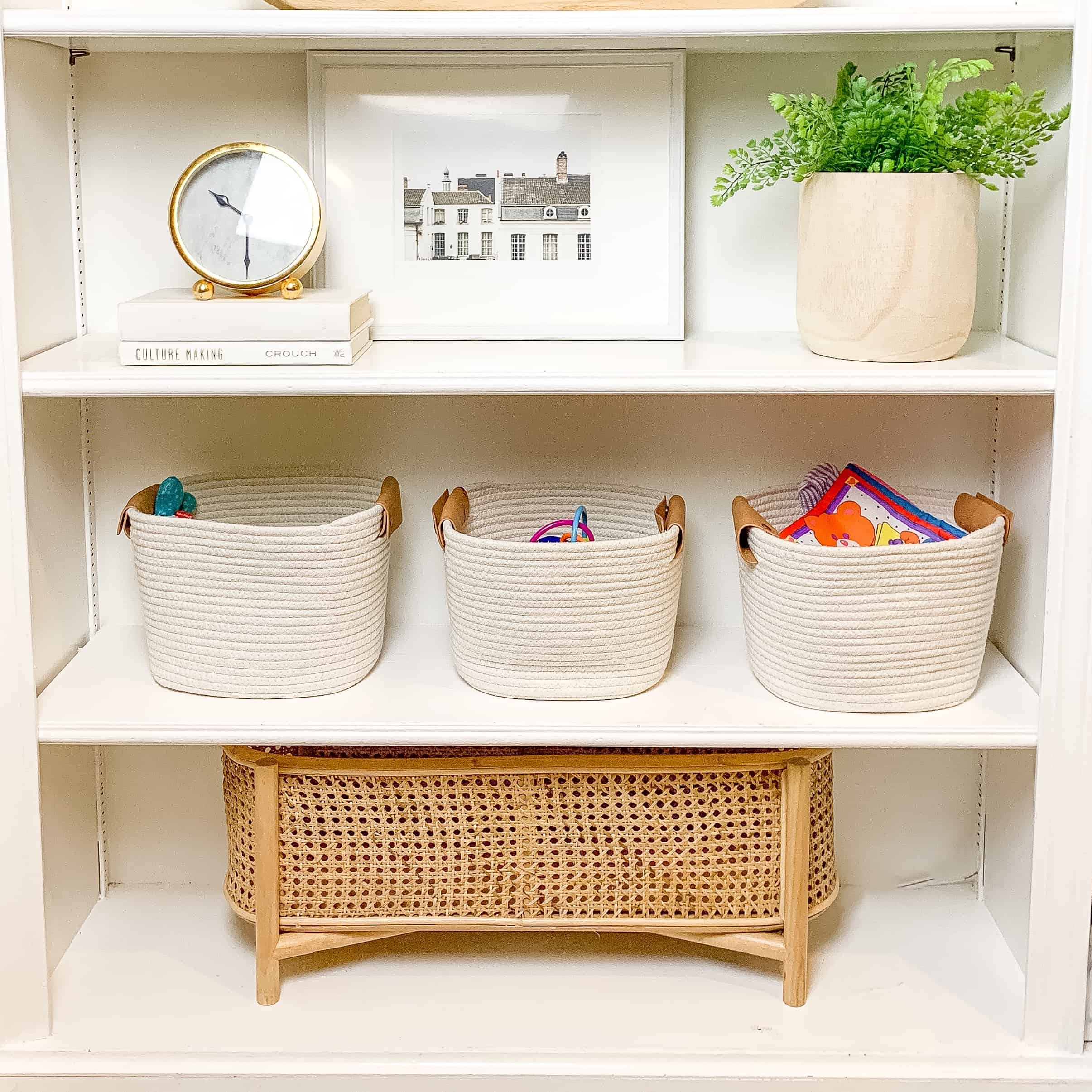 built ins with white baskets and natural decor