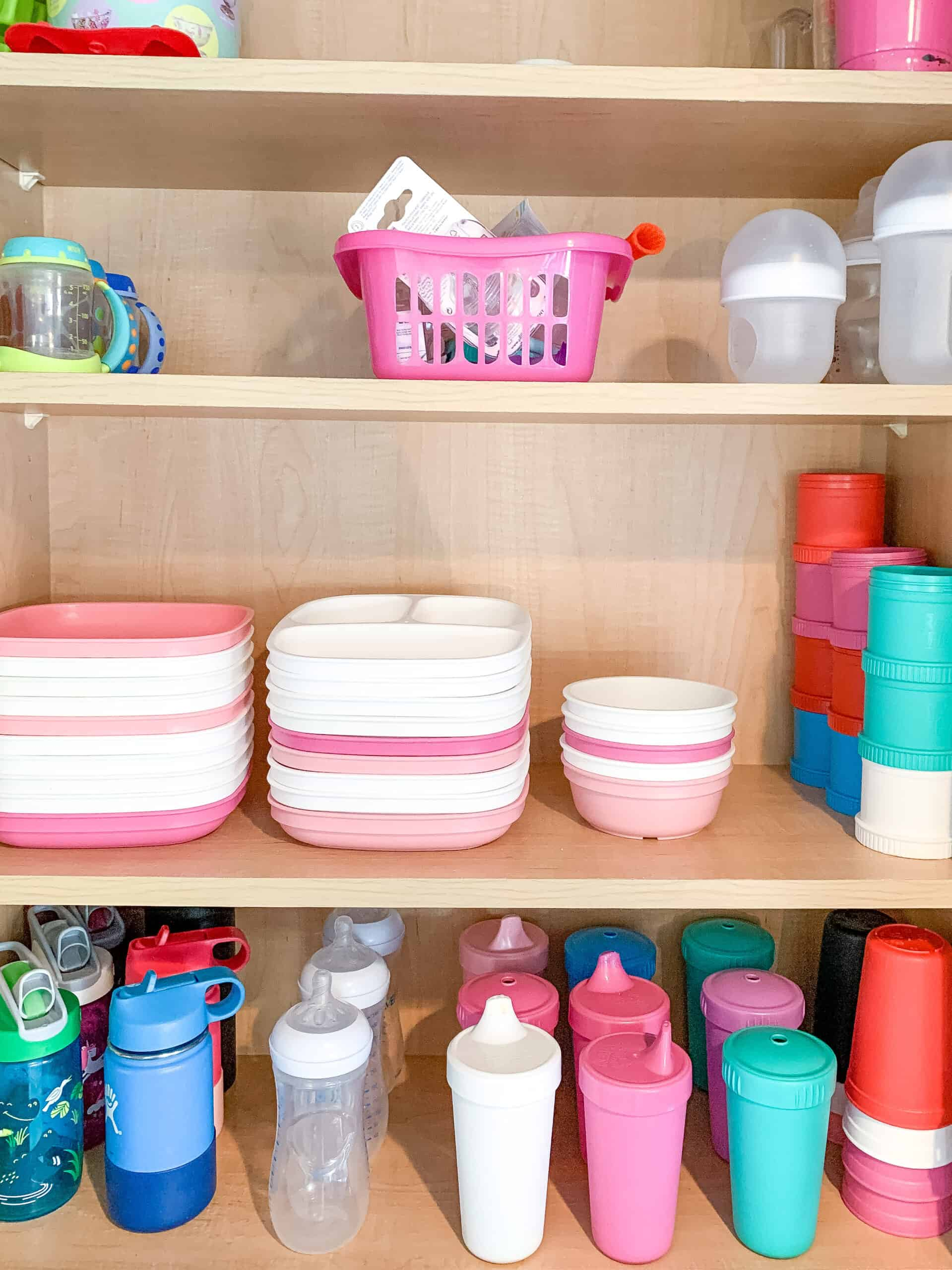 cupboard with replay recycled cups and plates organized